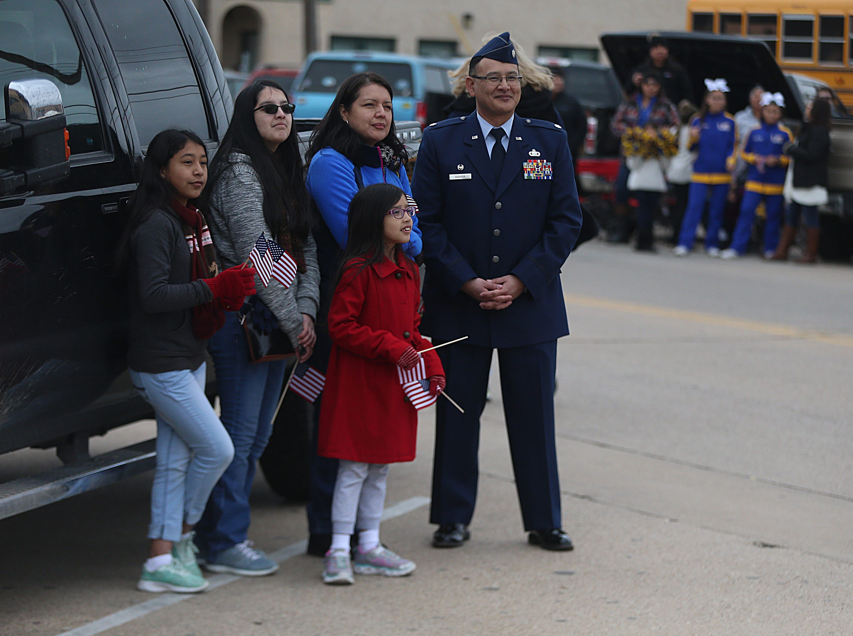 "Lt. Co. Sarabia and his family watch marchers Saturday, Nov. 10, 2018, during the 15th annual Veterans Day Parade, themed ""Honoring faithful freedom defenders."""