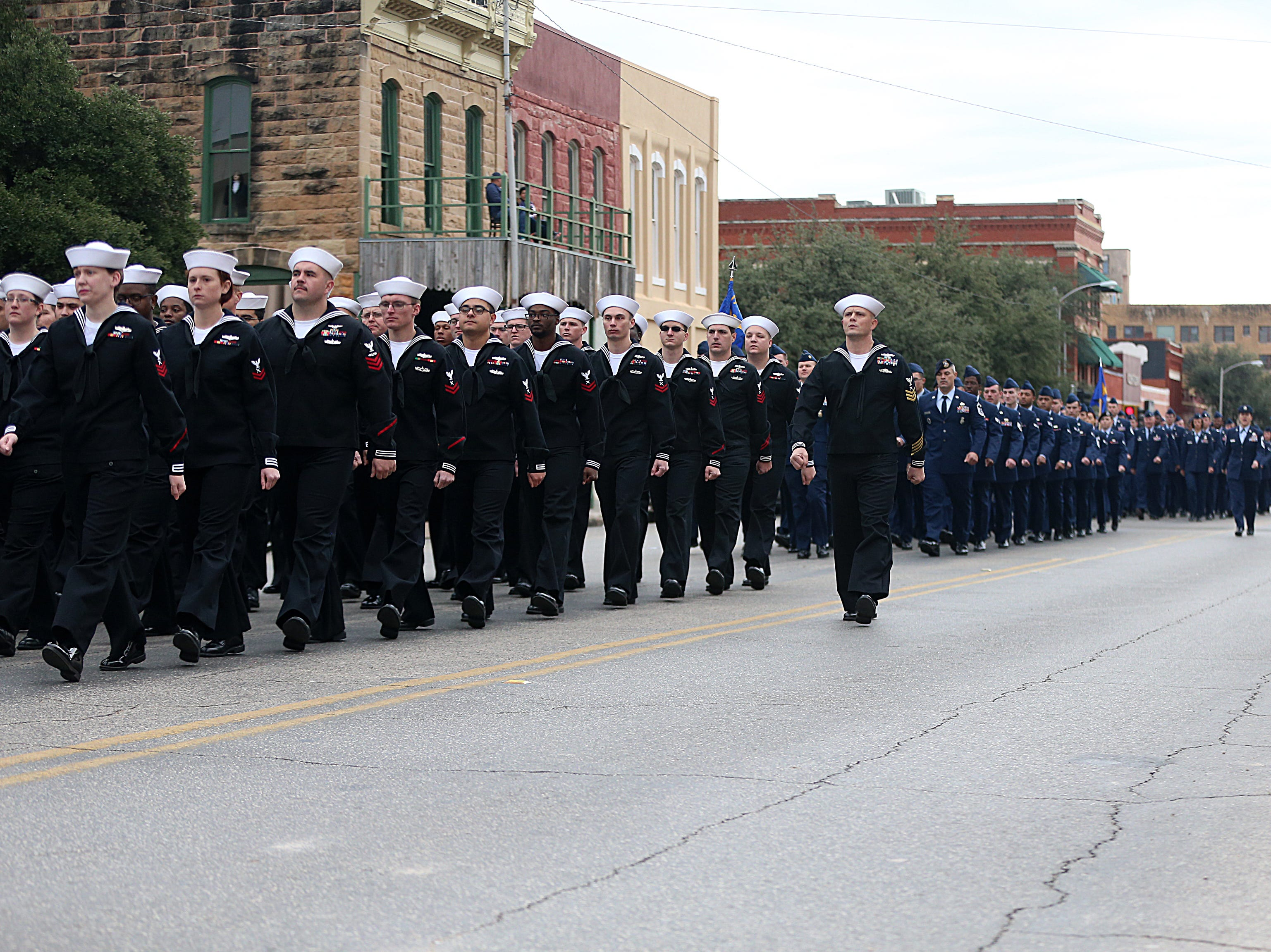 "Goodfellow Air Force's military detachments march in downtown San Angelo Saturday, Nov. 10, 2018, during the 15th annual Veterans Day Parade, themed ""Honoring faithful freedom defenders."""