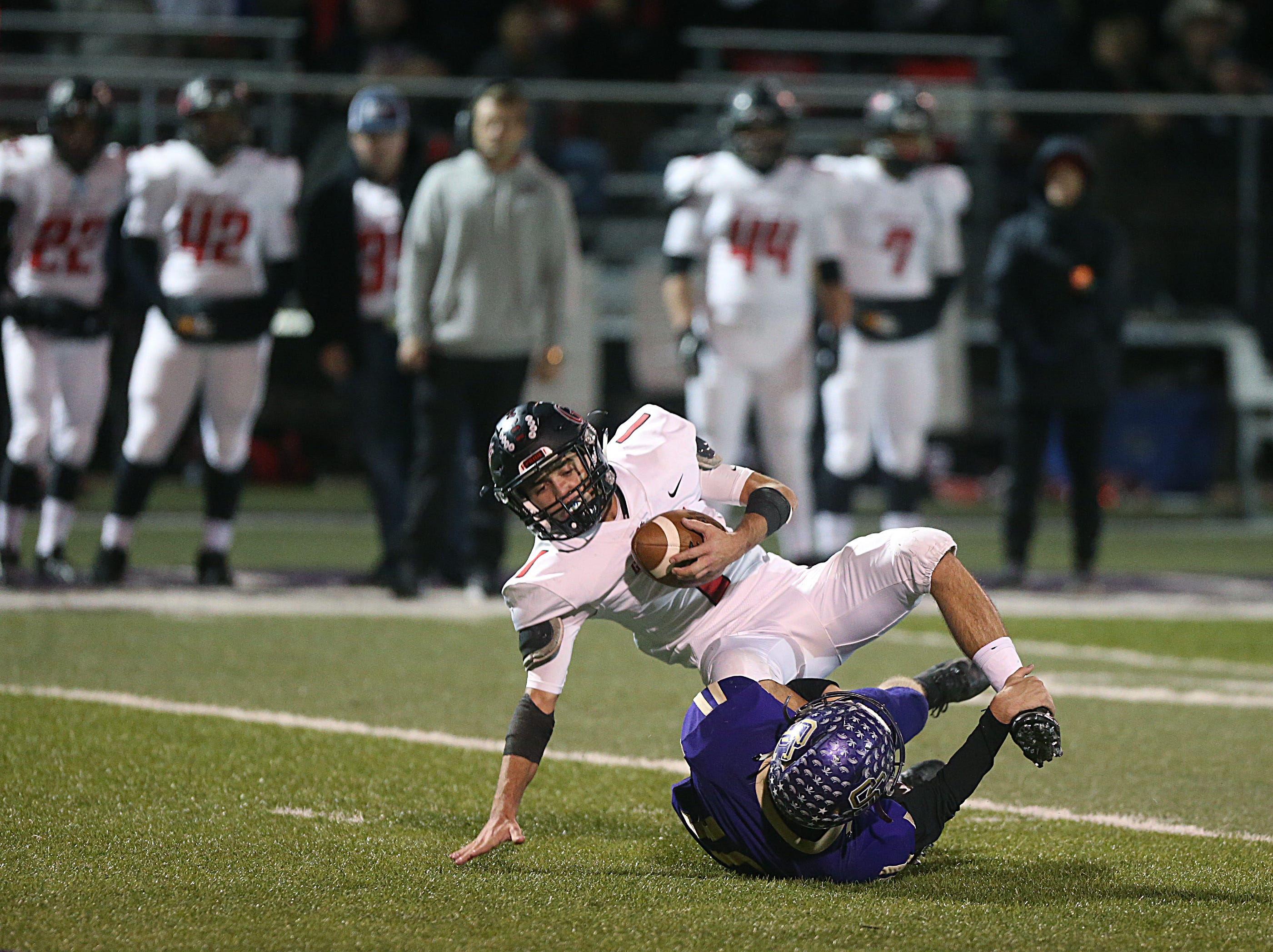 Garden City's Hunter McMillan (#1) is tripped up by Sterling City's Cross Knittel Friday, Nov. 9, 2018 during their game in Sterling City.