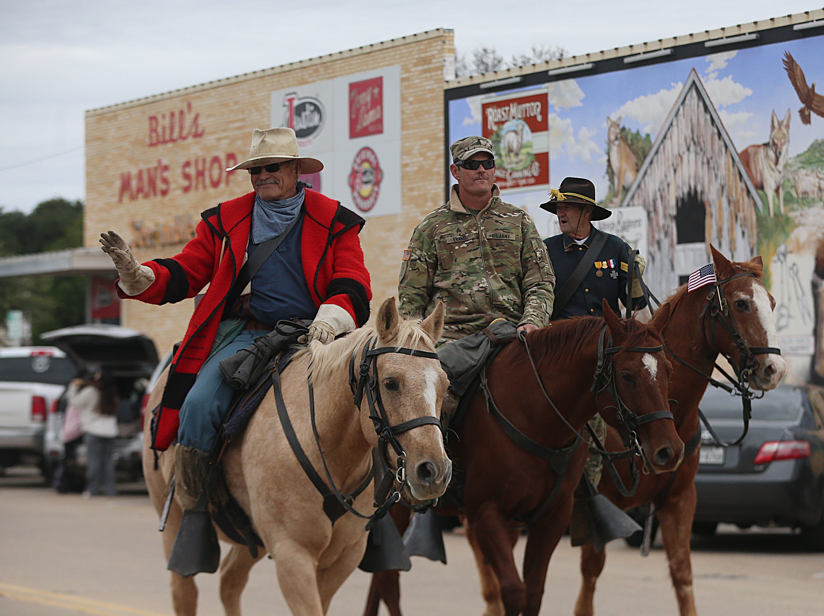 "Parade participants wave to spectators Saturday, Nov. 10, 2018, during the 15th annual Veterans Day Parade, themed ""Honoring faithful freedom defenders."""