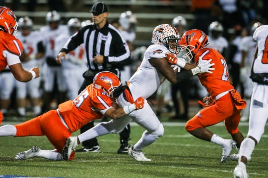 The San Angelo Central High School defense had its hands full with No. 12 Fort Worth Haltom in last week's 50-33 regular-season loss. The Bobcats travel to Arlington Lamar on Friday to open the playoffs.