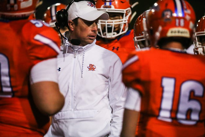 Central's assistant coach Kevin Crane talks with the team during the game against Haltom Friday, Nov. 9, 2018, at San Angelo Stadium.
