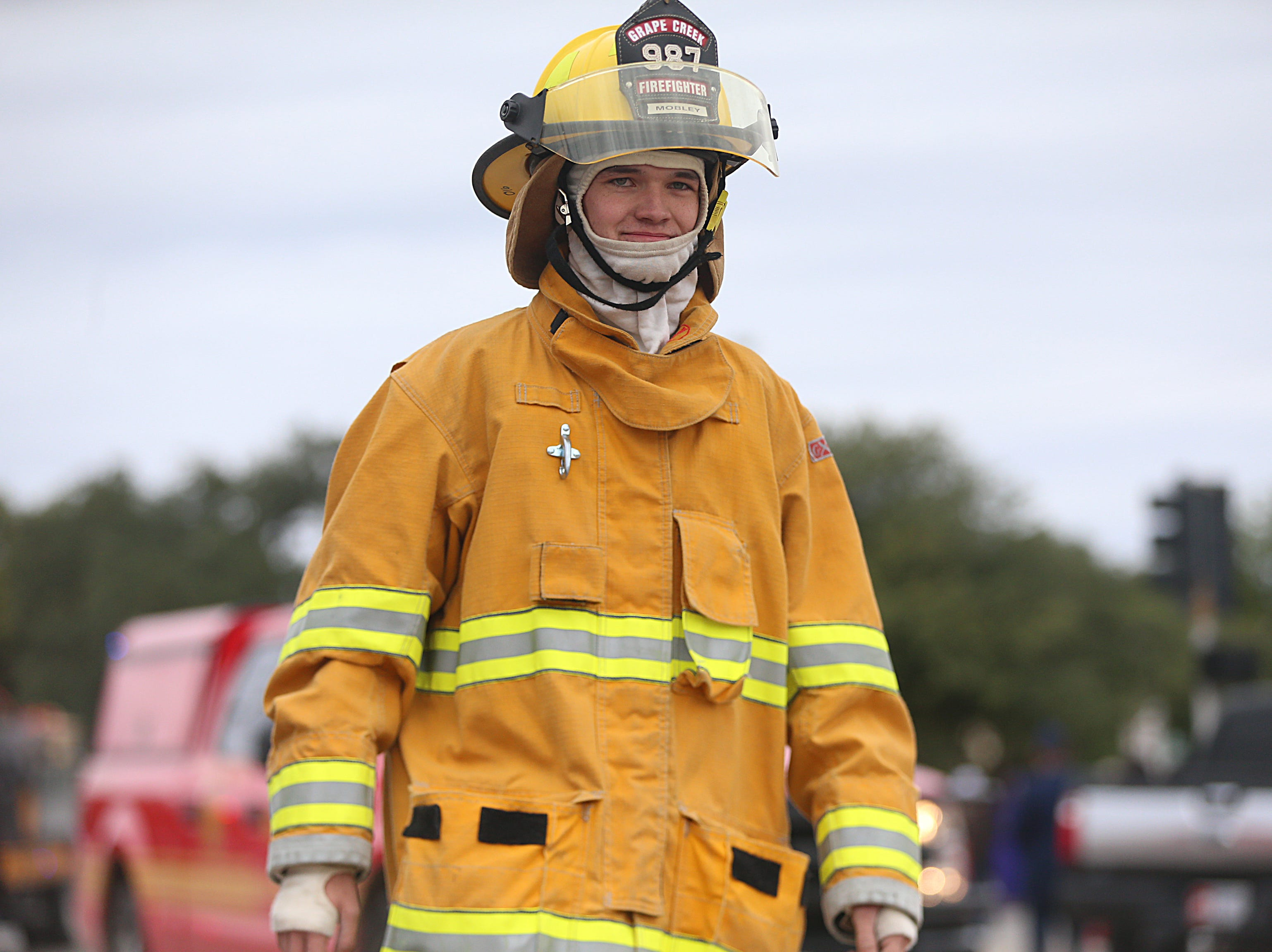 "A Grape Creek fire fighter marches downtown Saturday, Nov. 10, 2018, during the 15th annual Veterans Day Parade, themed ""Honoring faithful freedom defenders."""
