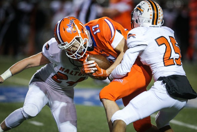 San Angelo Central wide receiver Tanner Dabbert battles for yardage after a catch against Fort Worth Haltom.