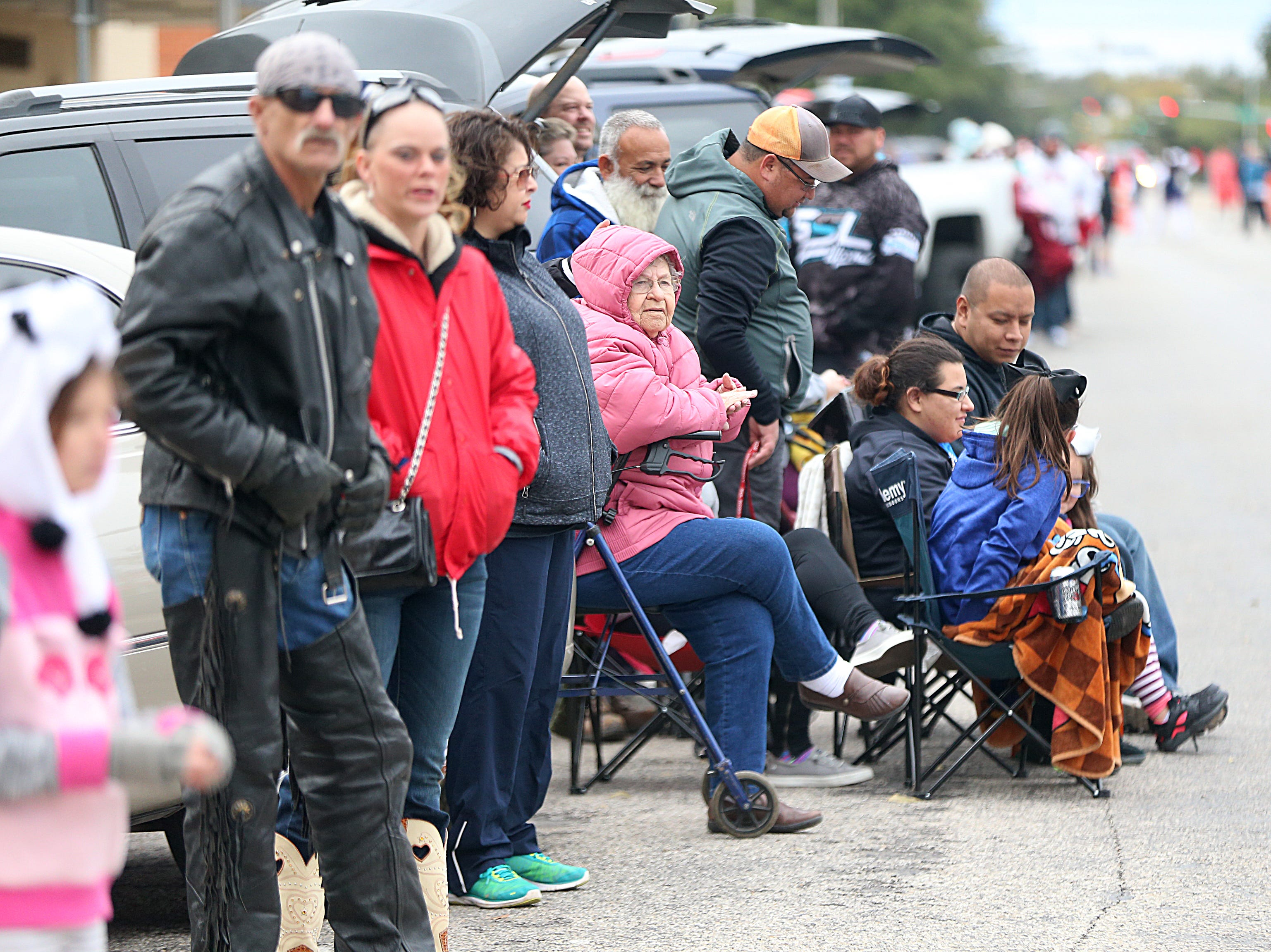 "Spectators wait for floats carrying veterans to pass by Saturday, Nov. 10, 2018, during the 15th annual Veterans Day Parade, themed ""Honoring faithful freedom defenders."""