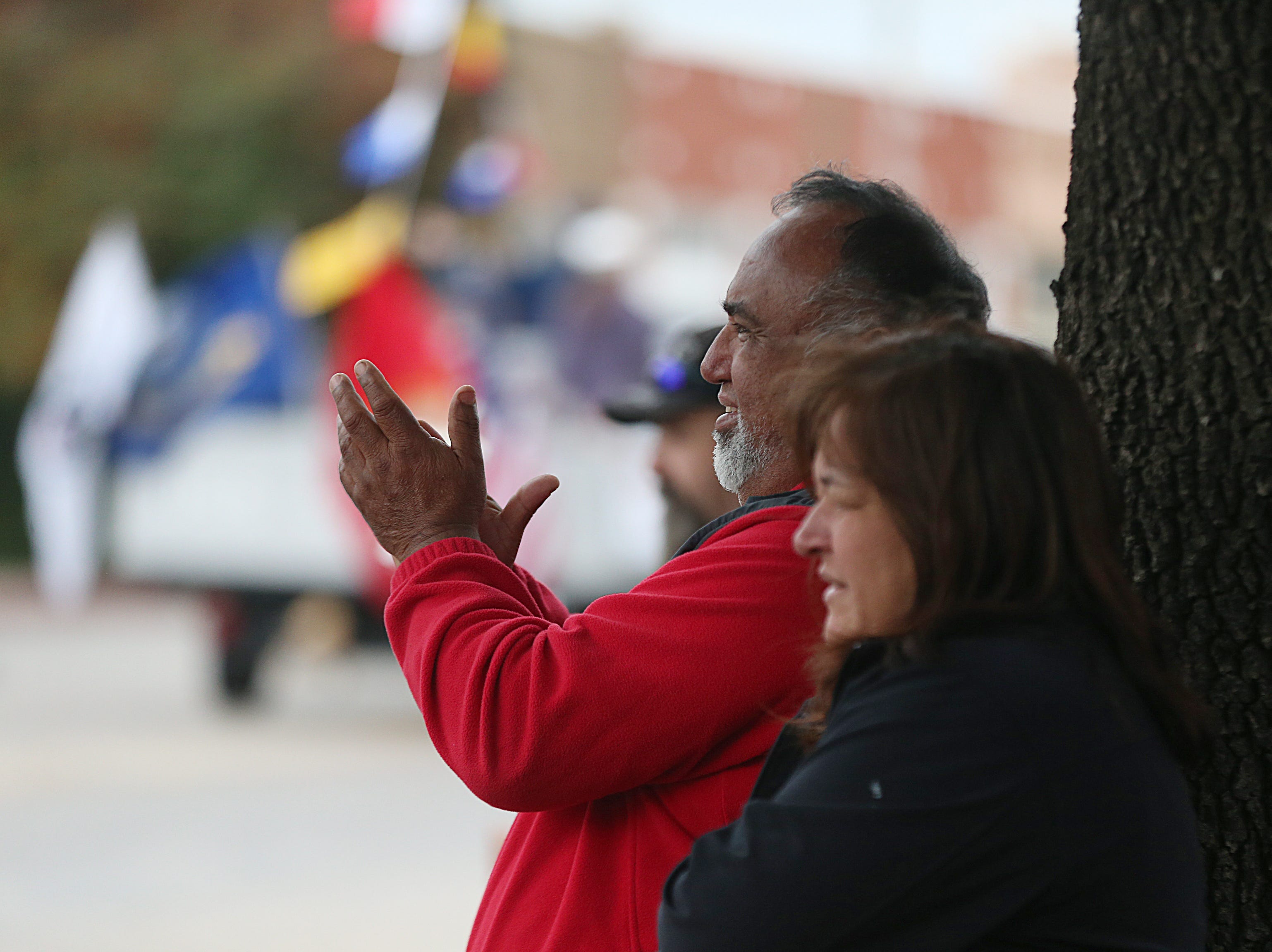 "Spectators cheer for veterans passing by in floats Saturday, Nov. 10, 2018, in the 15th annual Veterans Day Parade, themed ""Honoring faithful freedom defenders."""
