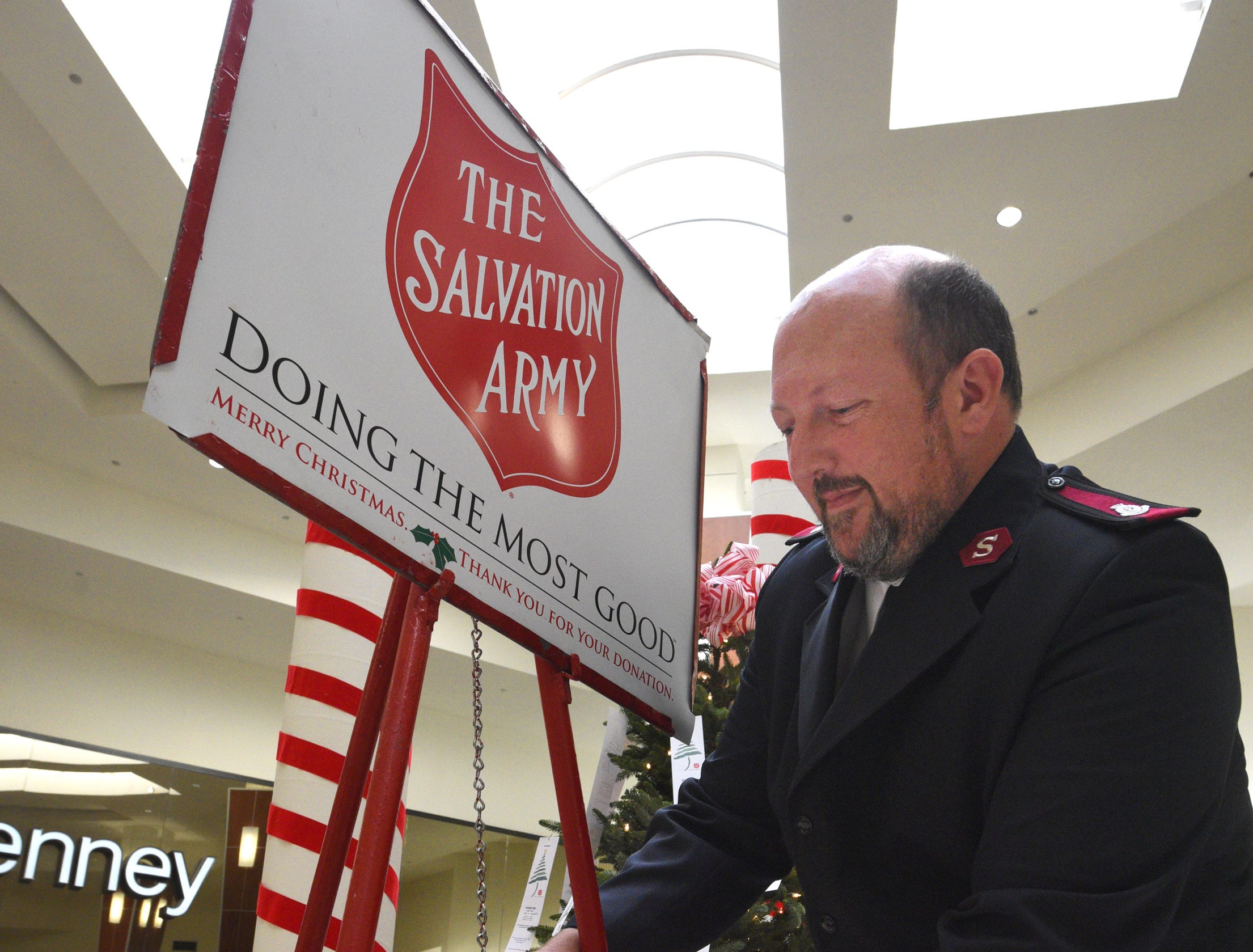 Salvation Army Maj. Ray Morton sets up their Red Kettle for donations at Bossier City's Pierre Bossier Mall.