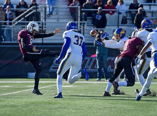 South Dakota State cornerback Don Gardner (21) blocks the punt by SIU punter Lane Reazin (98) in the second quarter at Saluki Stadium on Saturday in Carbondale. The Jackrabbits would recover the ball for a touchdown.