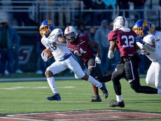 South Dakota State running back Pierre Strong Jr. (20) heads to the end zone on a 72-yard touchdown run in the second quarter against Southern Illinois at Saluki Stadium on Saturday in Carbondale.
