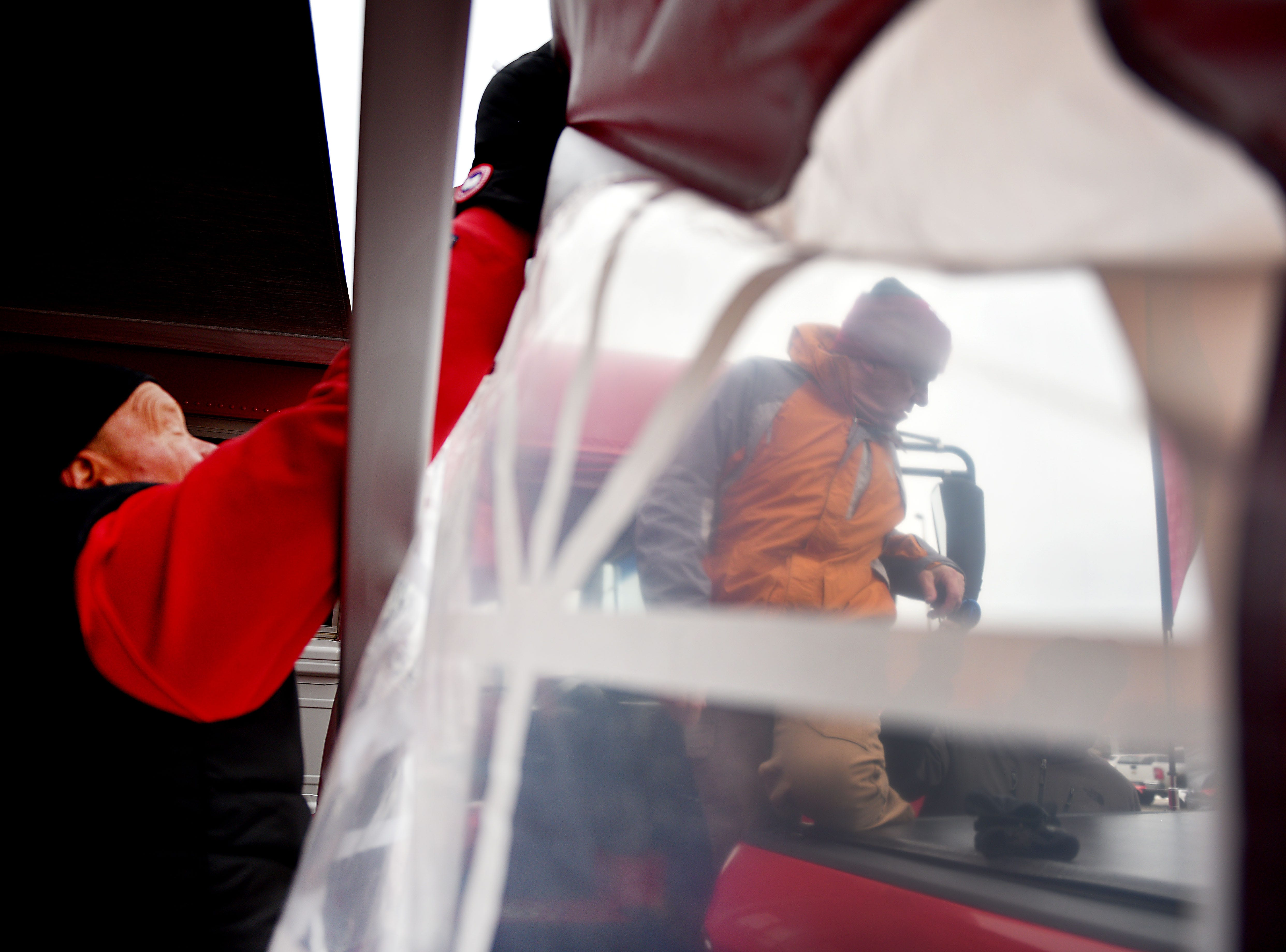 USD fan Dave Hultgren, left, and Dave Zimbeck set up a tent around a tailgate before the game against Western Illinois Saturday, Nov. 10, at the DakotaDome in Vermillion.