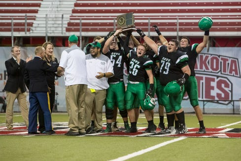 Pierre's football team celebrates winning the class 11AA championship, Friday, Nov. 9, 2018 at the DakotaDome in Vermillion, S.D.