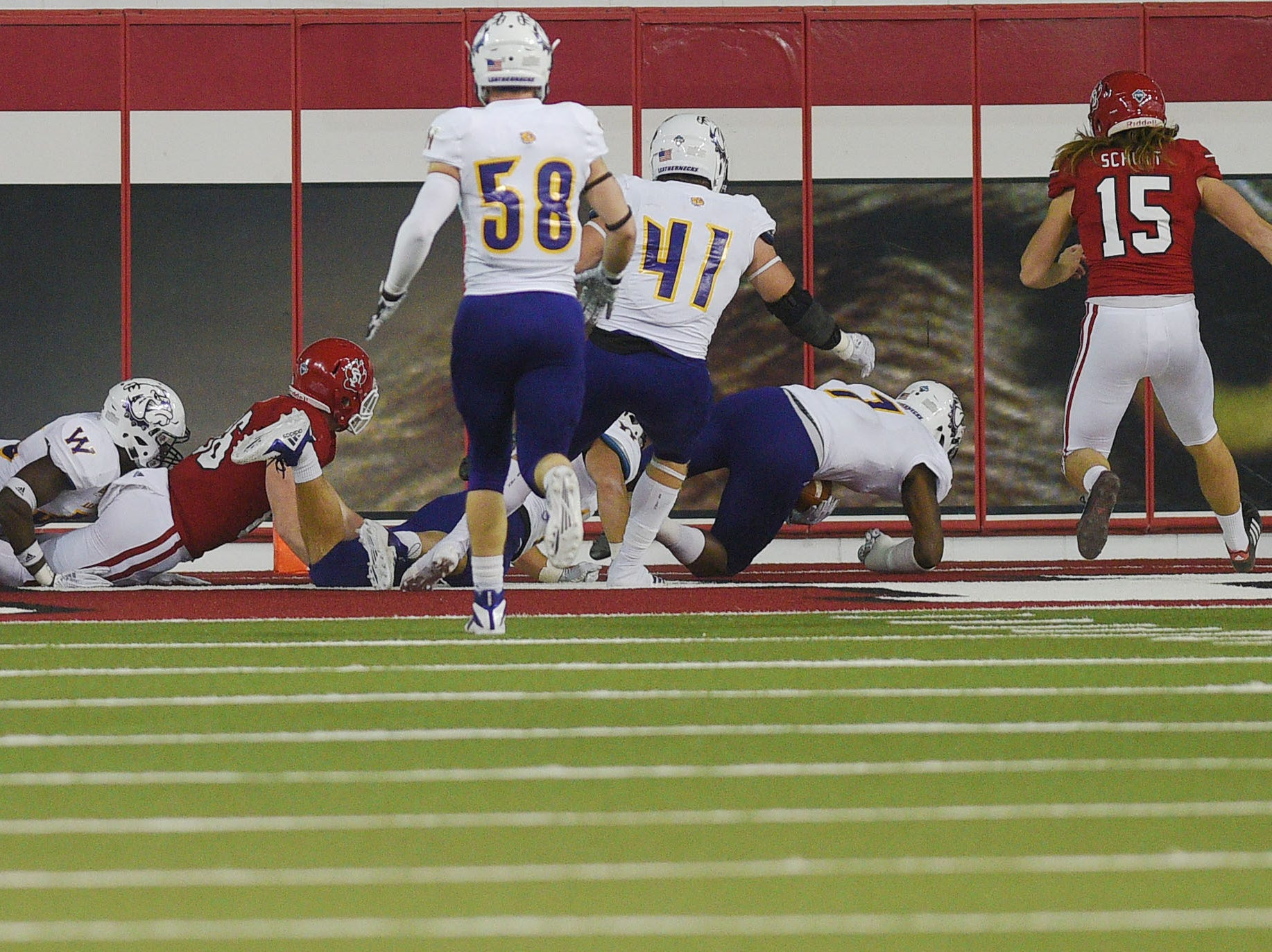 Western Illinois blocks a punt and recovers it for a touchdown during the game against USD Saturday, Nov. 10, at the DakotaDome in Vermillion.