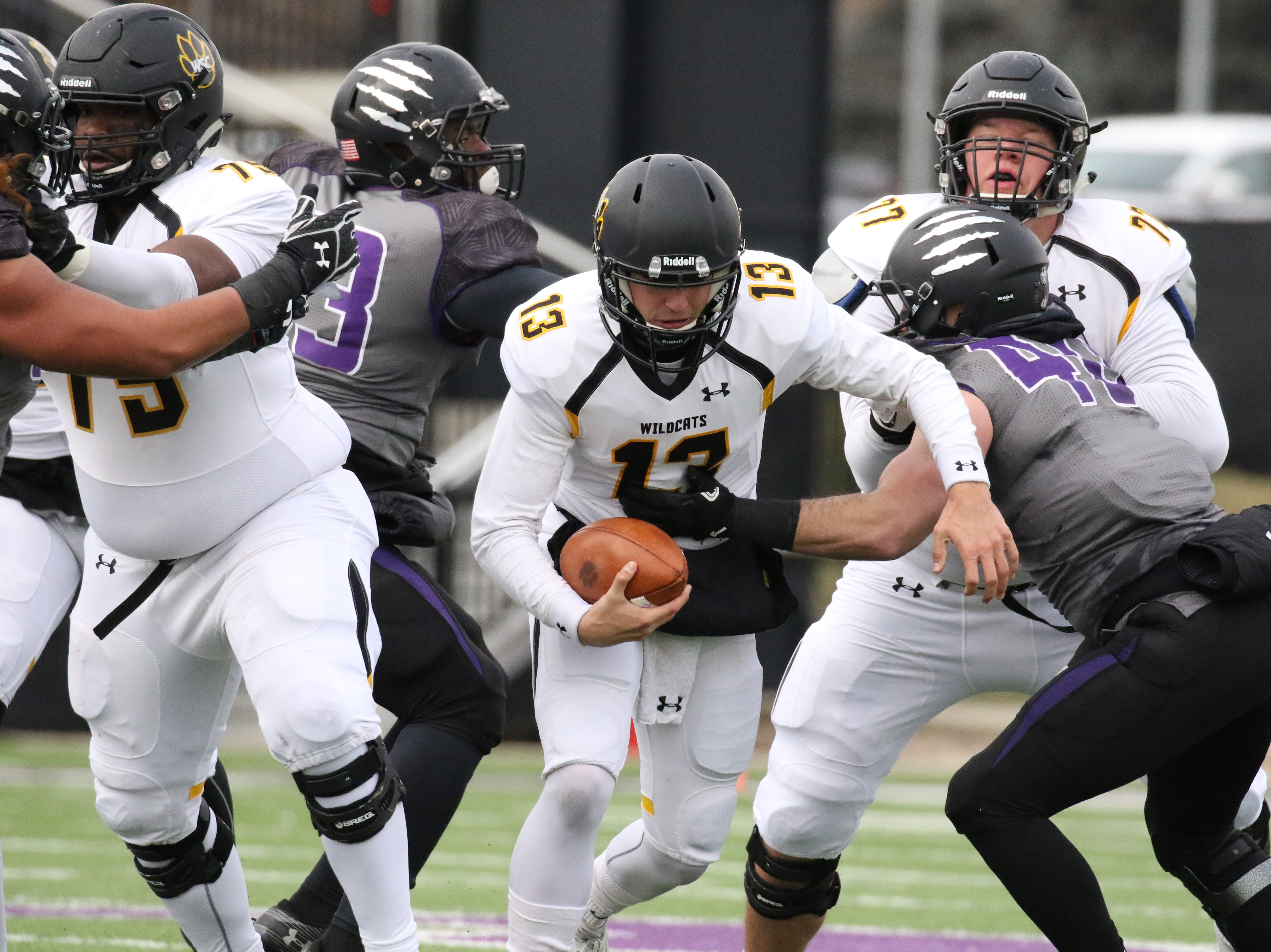Brady Brandsfield of Wayne State is wrapped up by Shayden Drey of University of Sioux Falls during Saturday's game at Bob Young Field in Sioux Falls.