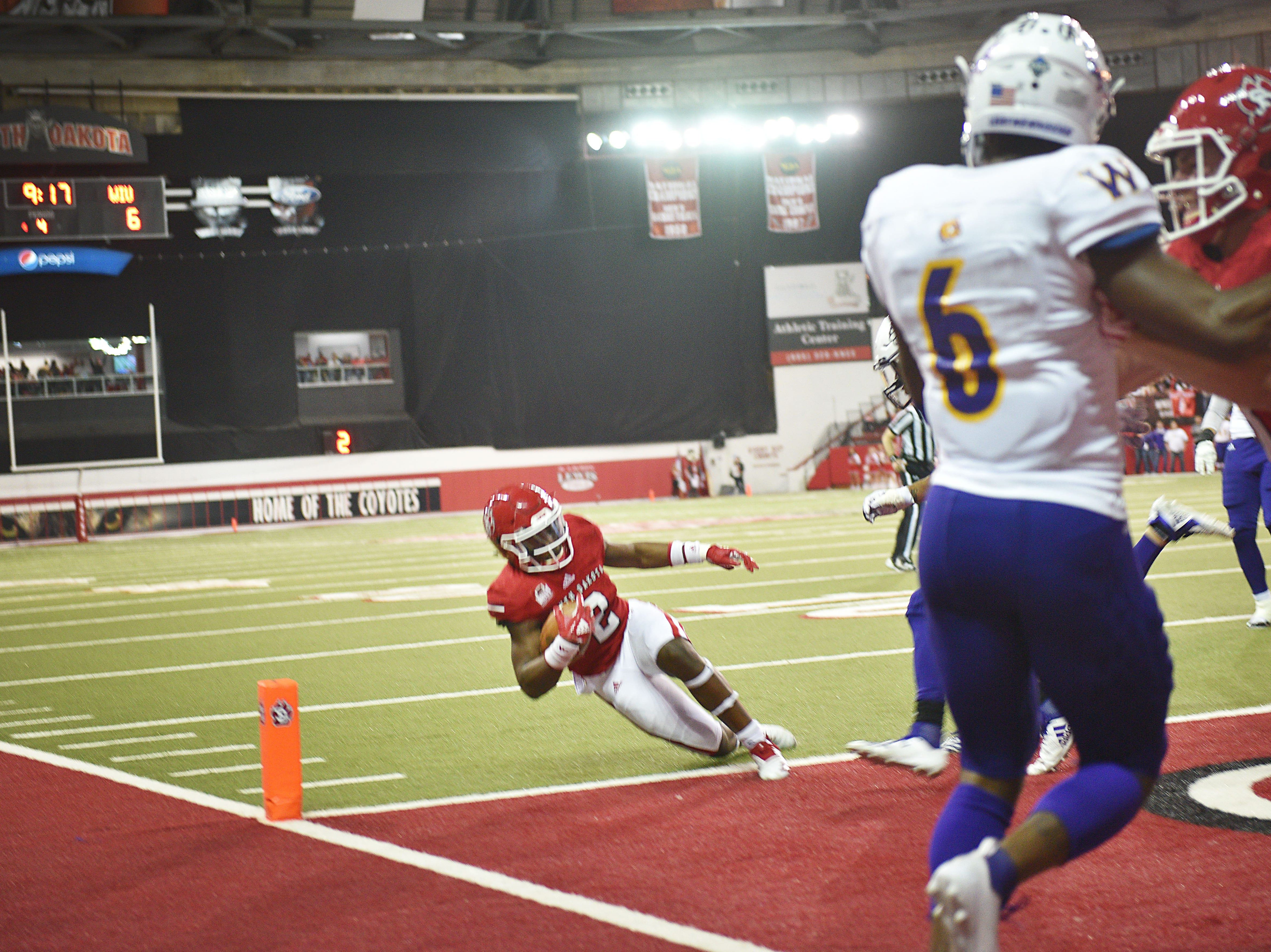 USD's Kai Henry scores a touchdown against Western Illinois during the game Saturday, Nov. 10, at the DakotaDome in Vermillion.