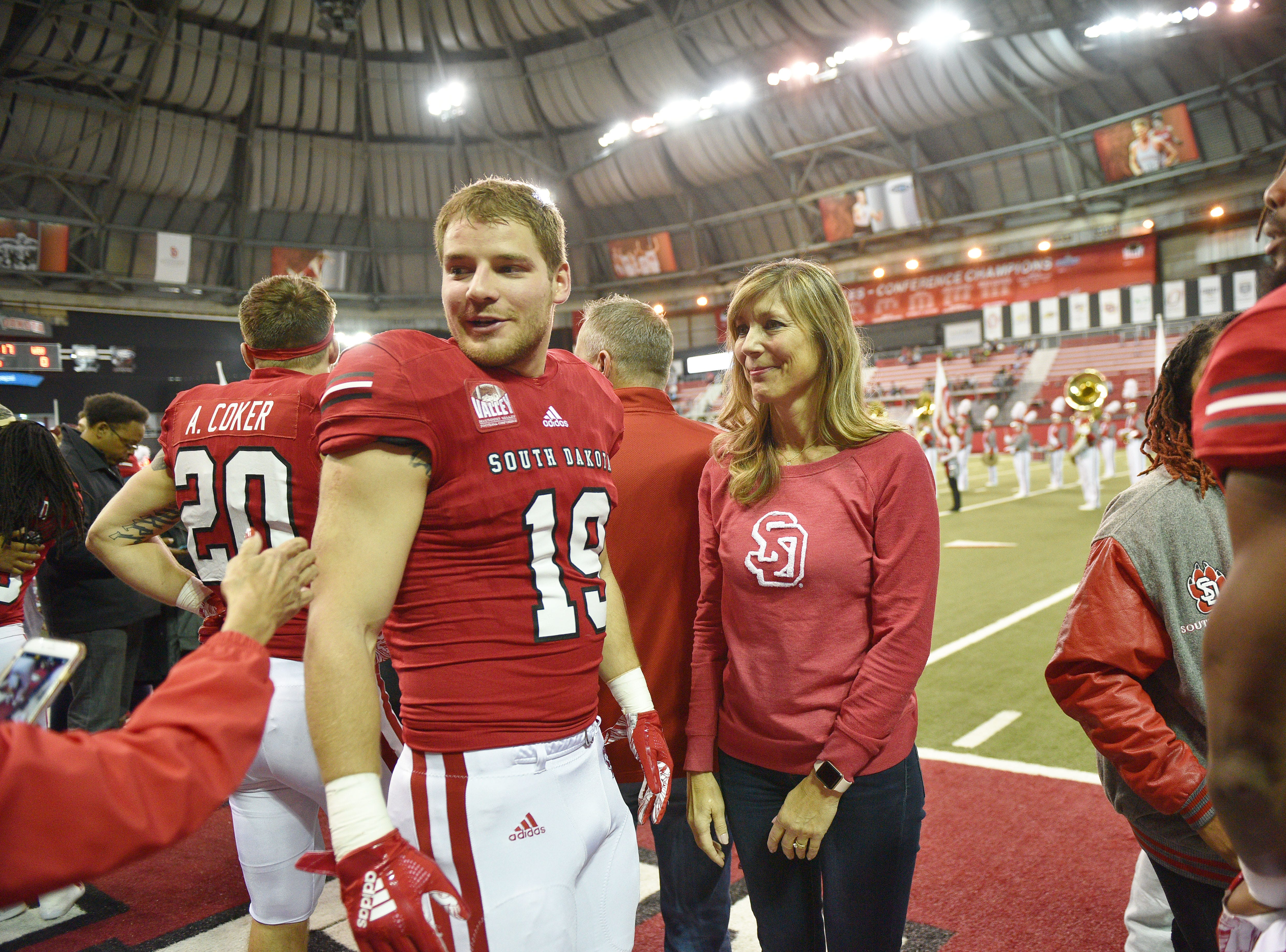 USD's Clay Fisher celebrates senior night before going on the field before the game against Western Illinois Saturday, Nov. 10, at the DakotaDome in Vermillion.