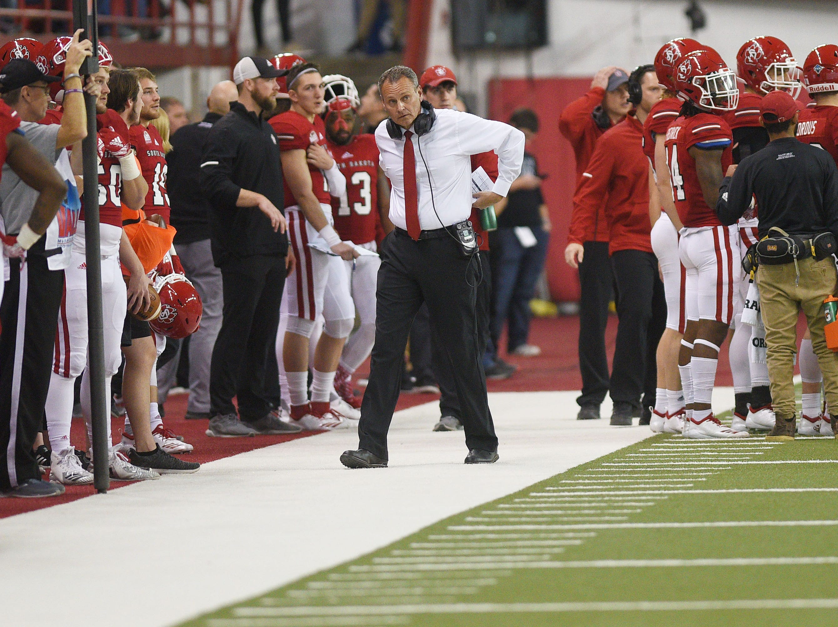 USD's Bob Nielson prepares to walk off the field after the win against Western Illinois Saturday, Nov. 10, at the DakotaDome in Vermillion.