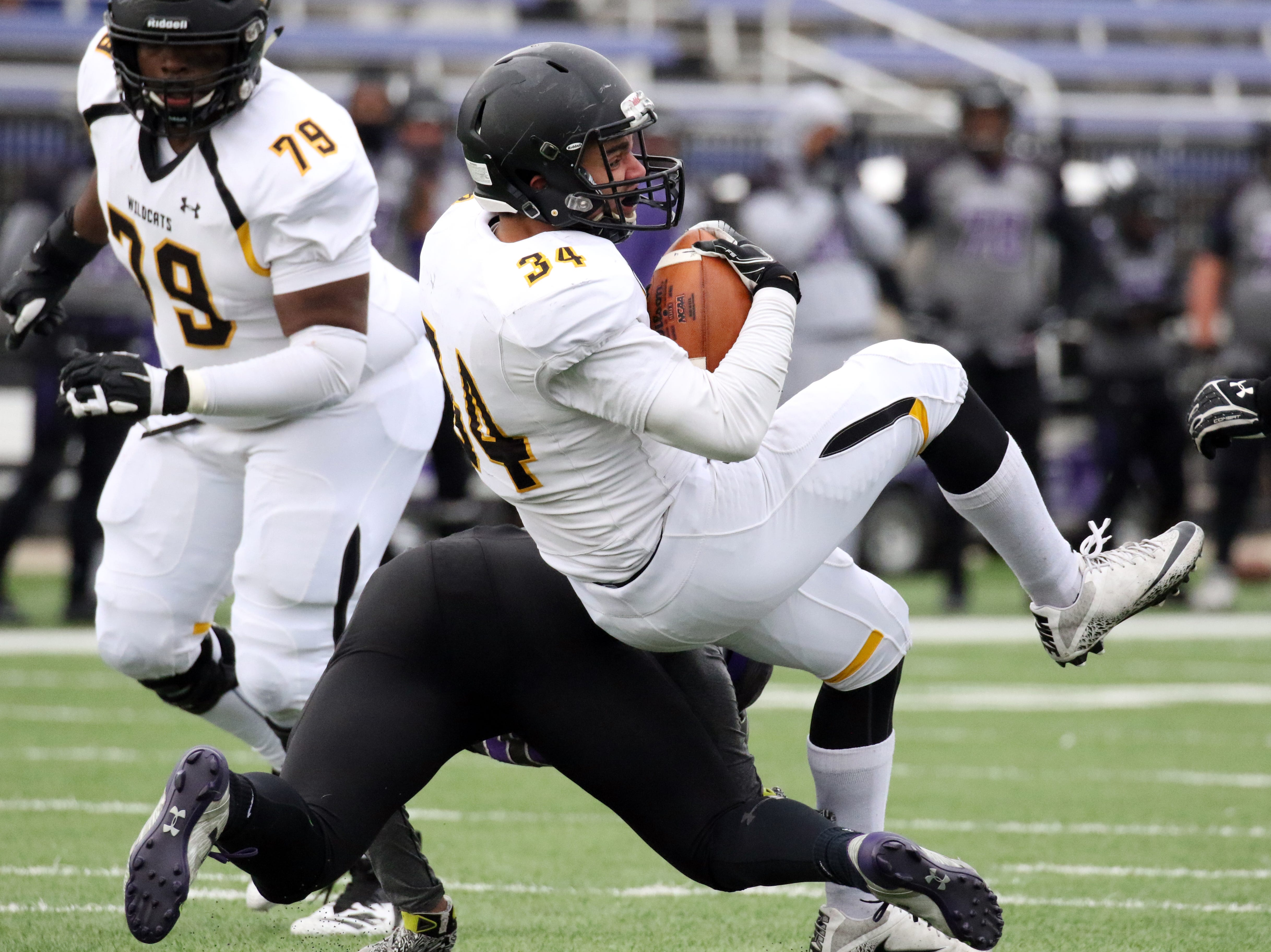 Wayne State RB, Maliki Wilson is upended by Aaron Ortiz of the University of Sioux Falls during Saturday's game at Bob Young Field in Sioux Falls.