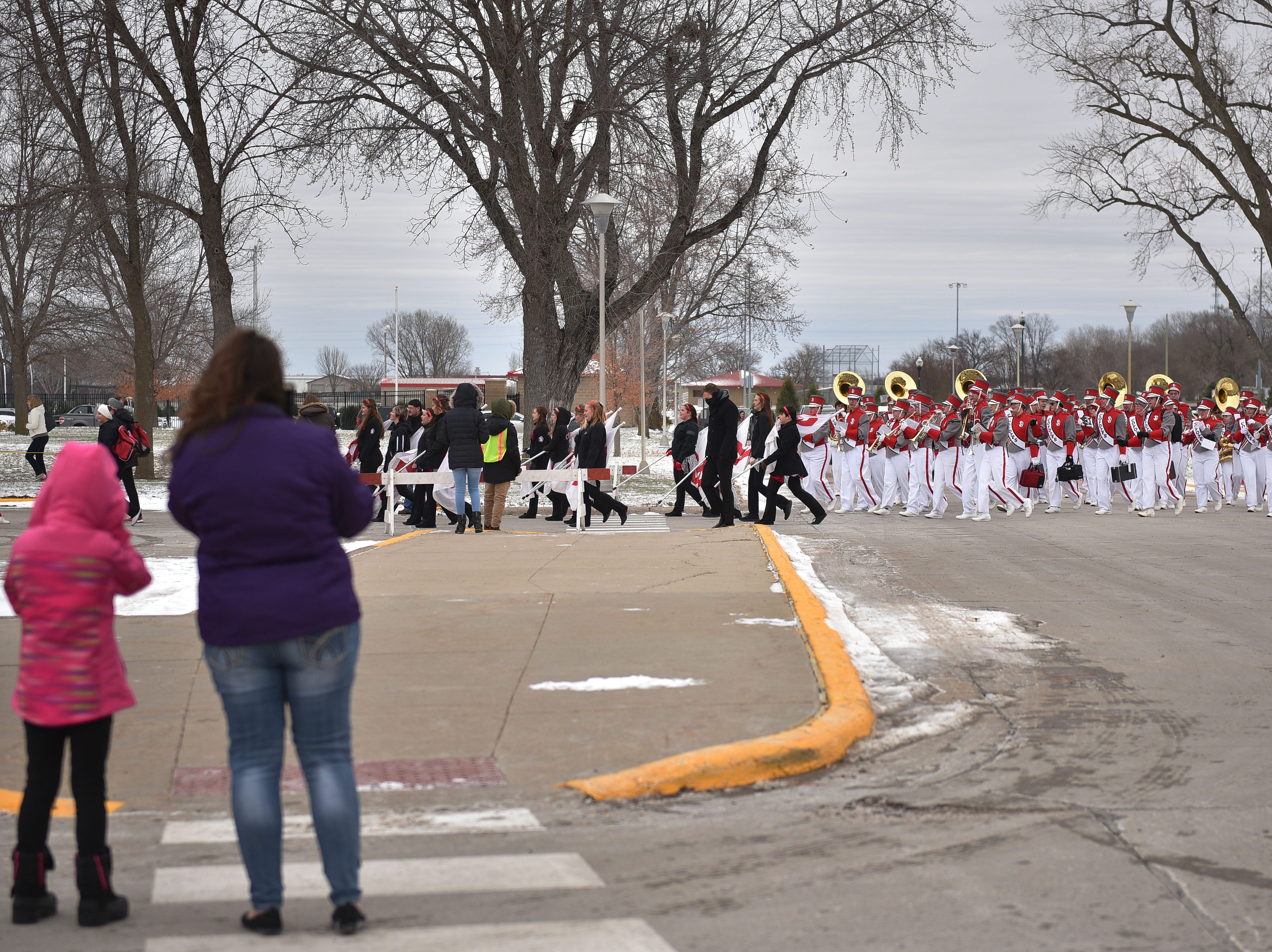 USD's band makes it's way through the tailgate before the game against Western Illinois Saturday, Nov. 10, at the DakotaDome in Vermillion.
