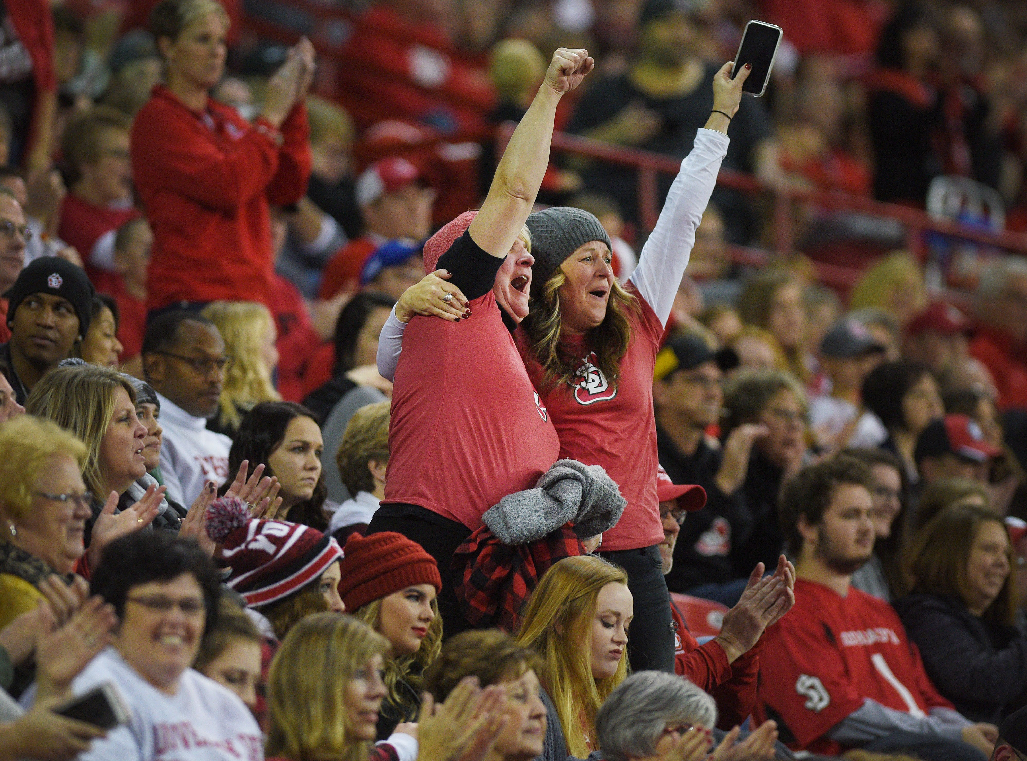 USD fans cheer during the game against Western Illinois Saturday, Nov. 10, at the DakotaDome in Vermillion.