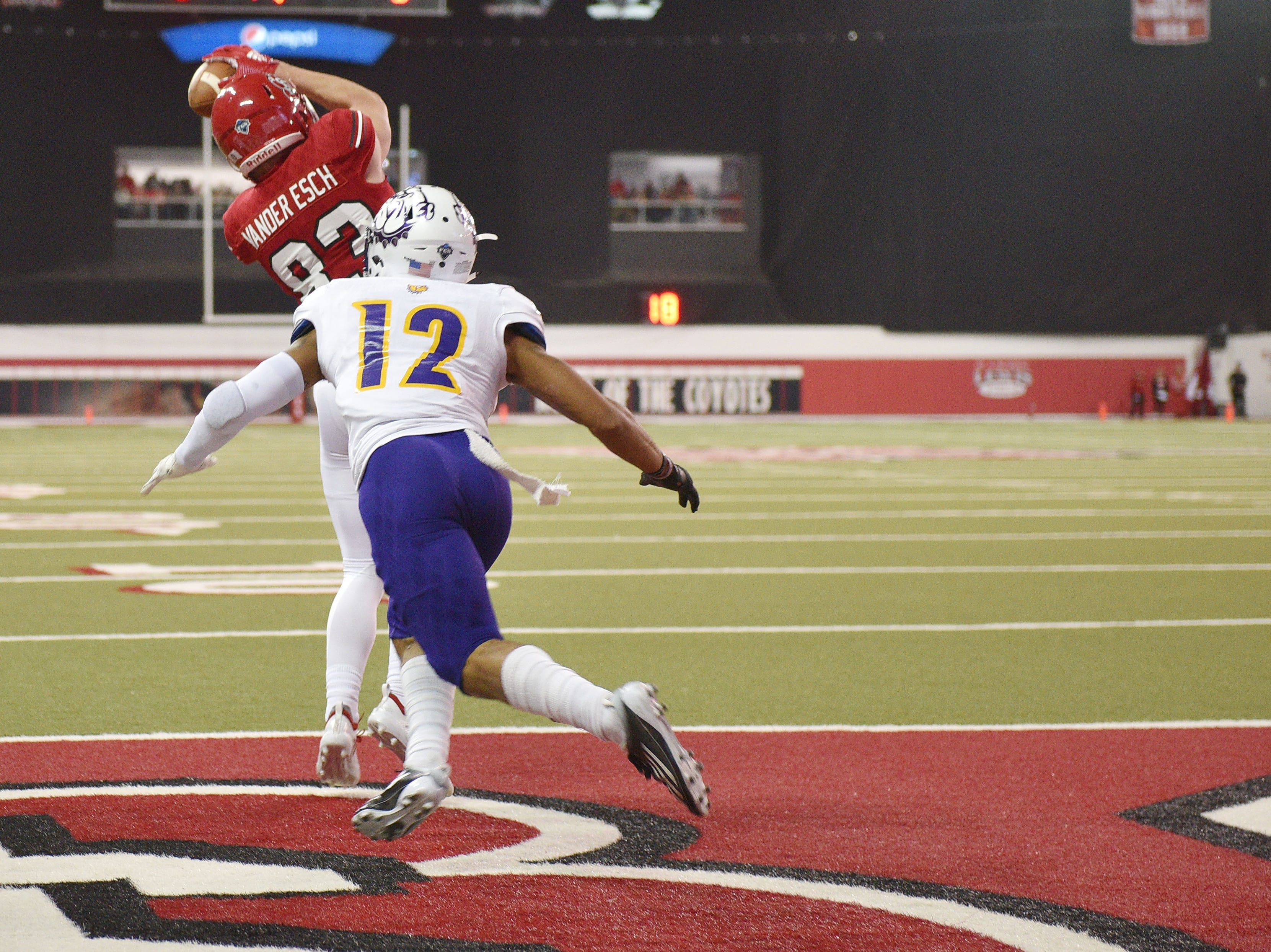 USD's Caleb Vander Esch scores a touchdown in the end zone against Western Illinois' Darron Wheeler during the game Saturday, Nov. 10, at the DakotaDome in Vermillion.