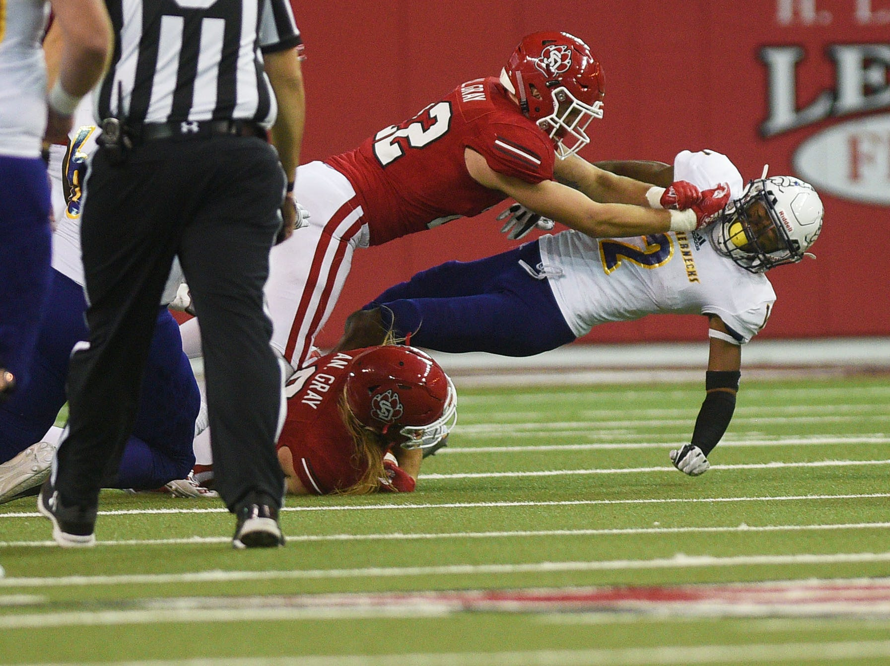 USD's Alex Gray tackles Western Illinois' IsaiahLeSure during the game Saturday, Nov. 10, at the DakotaDome in Vermillion.