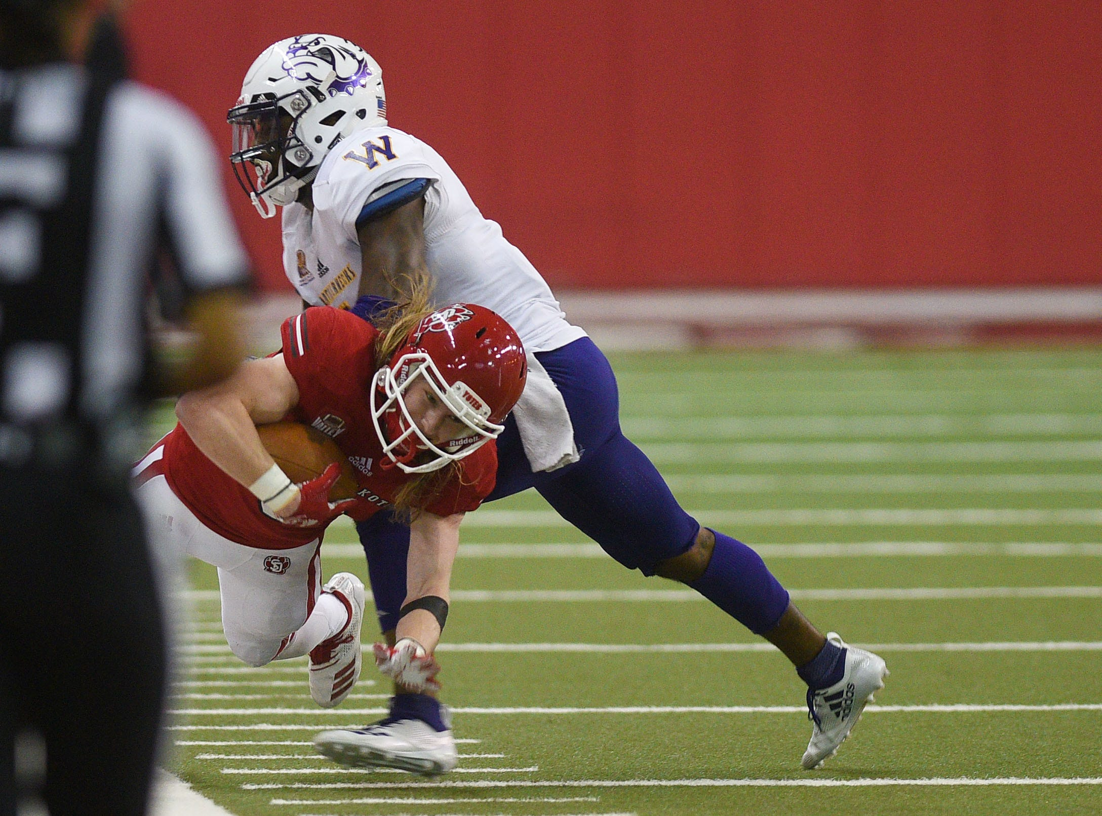 USD's Kody Case attempts to stay inbounds during the game against Western Illinois Saturday, Nov. 10, at the DakotaDome in Vermillion.