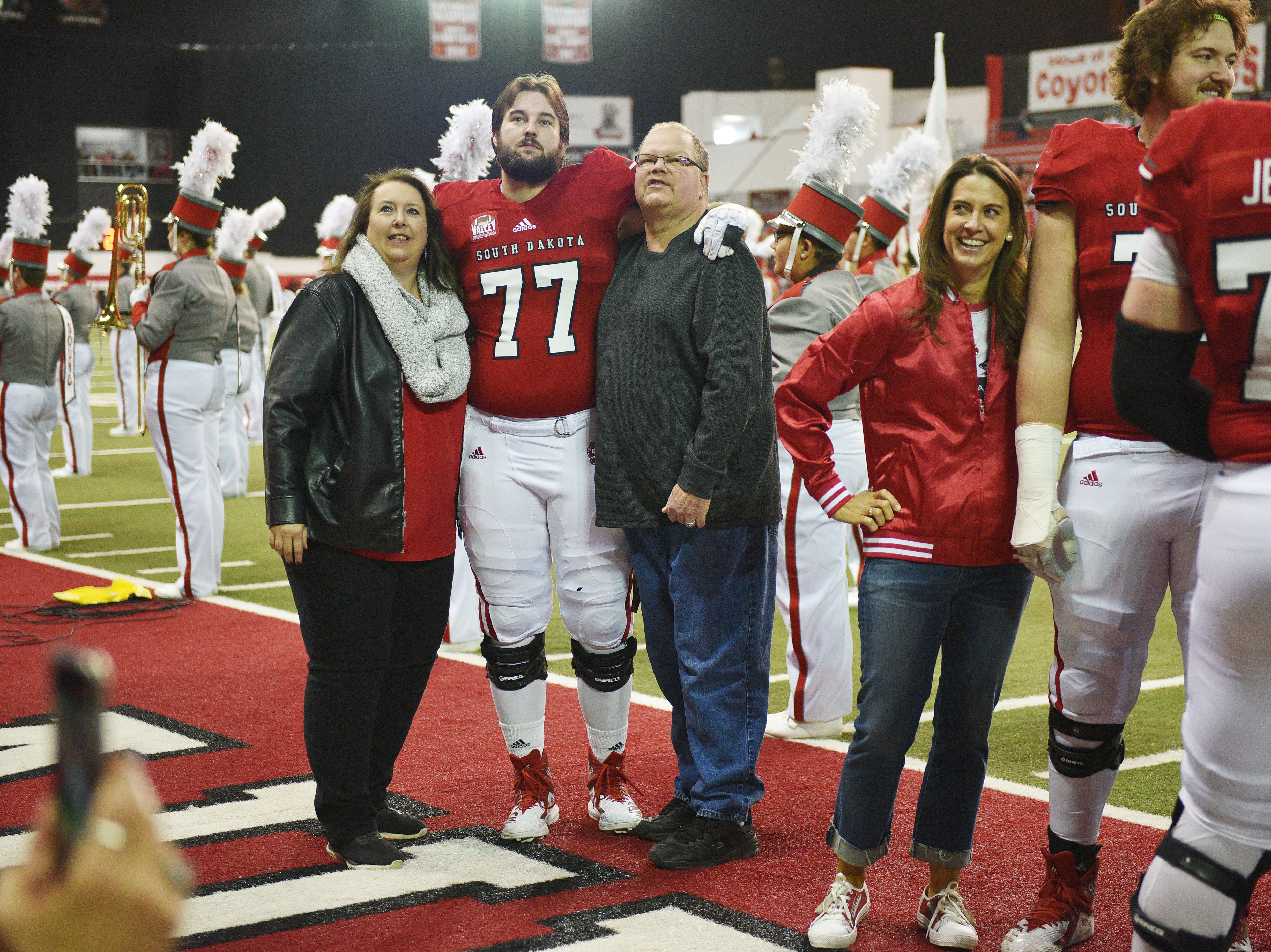 USD's Tanner Anderson celebrates senior night with his parents before going on the field for the game against Western Illinois Saturday, Nov. 10, at the DakotaDome in Vermillion.