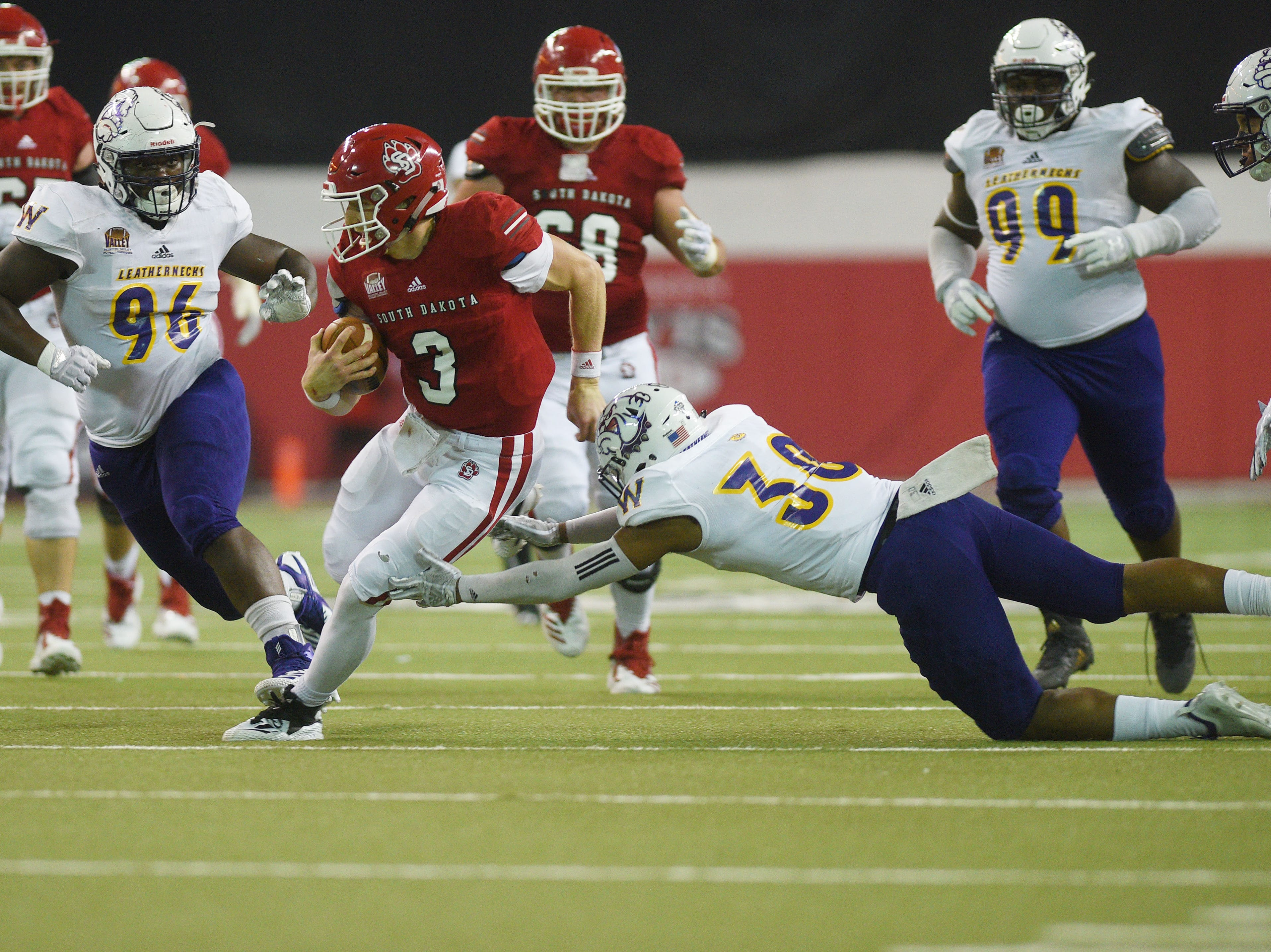 Western Illinois' Justin Fitzpatrick attempts to tackle USD's Austin Simmons during the game Saturday, Nov. 10, at the DakotaDome in Vermillion.