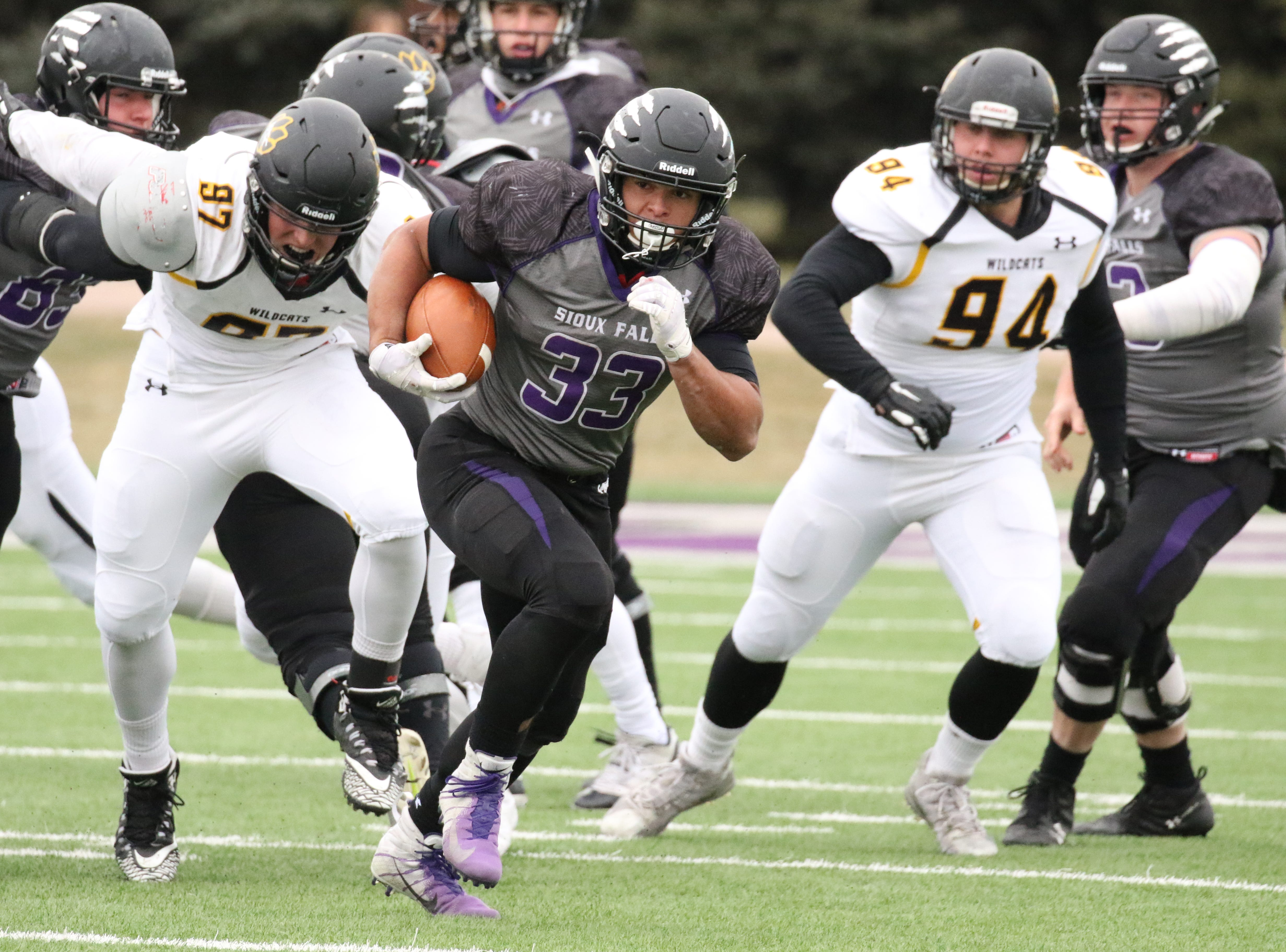 University of Sioux Falls RB, Gabriel Watson sprints into the open for a long gain during Saturday's game against Wayne State in Sioux Falls.