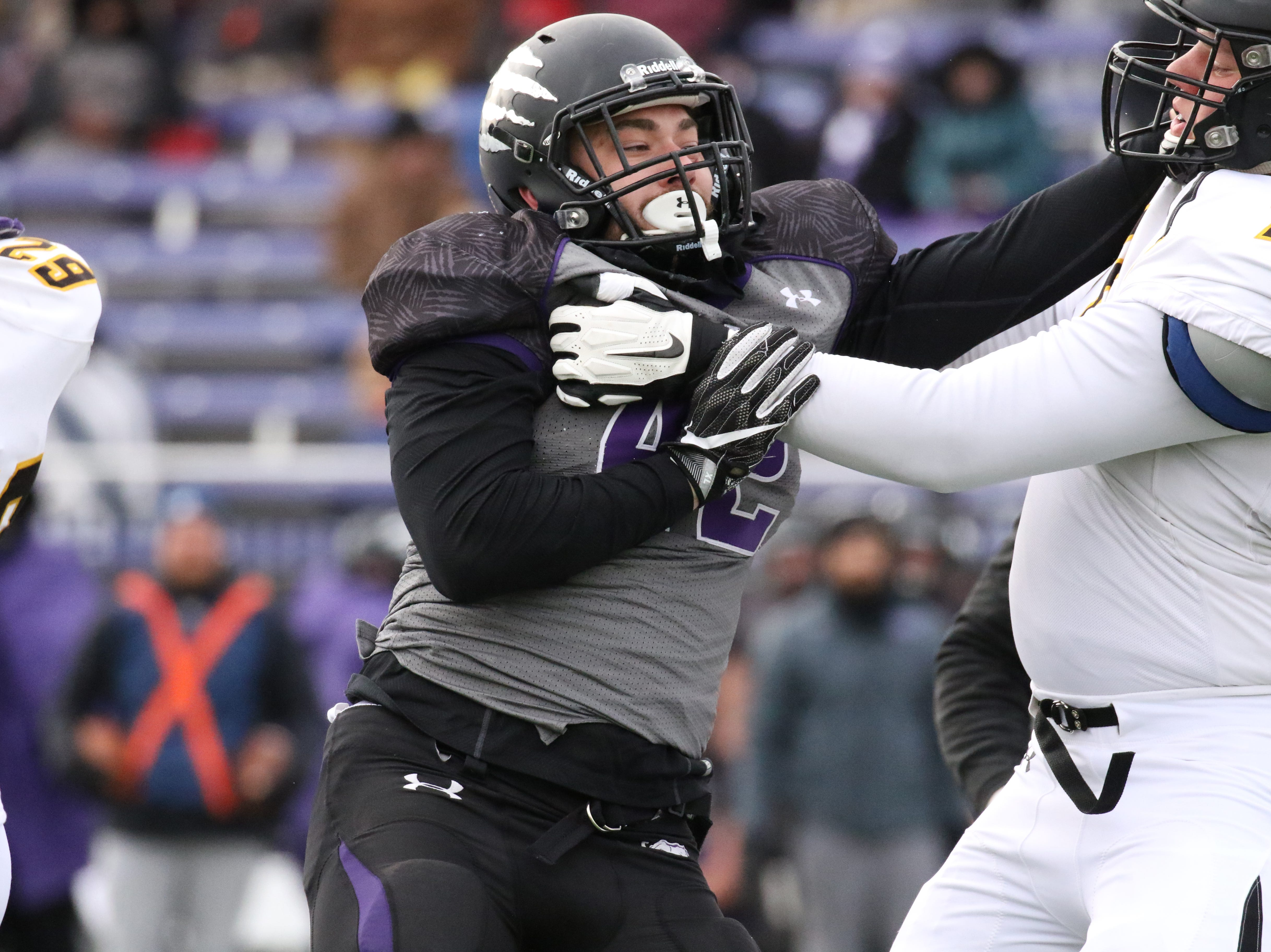 University of Sioux Falls defensive end Aaron Ortiz rushes against Nick Gray of Wayne State during Saturday's game at Bob Young Field in Sioux Falls.