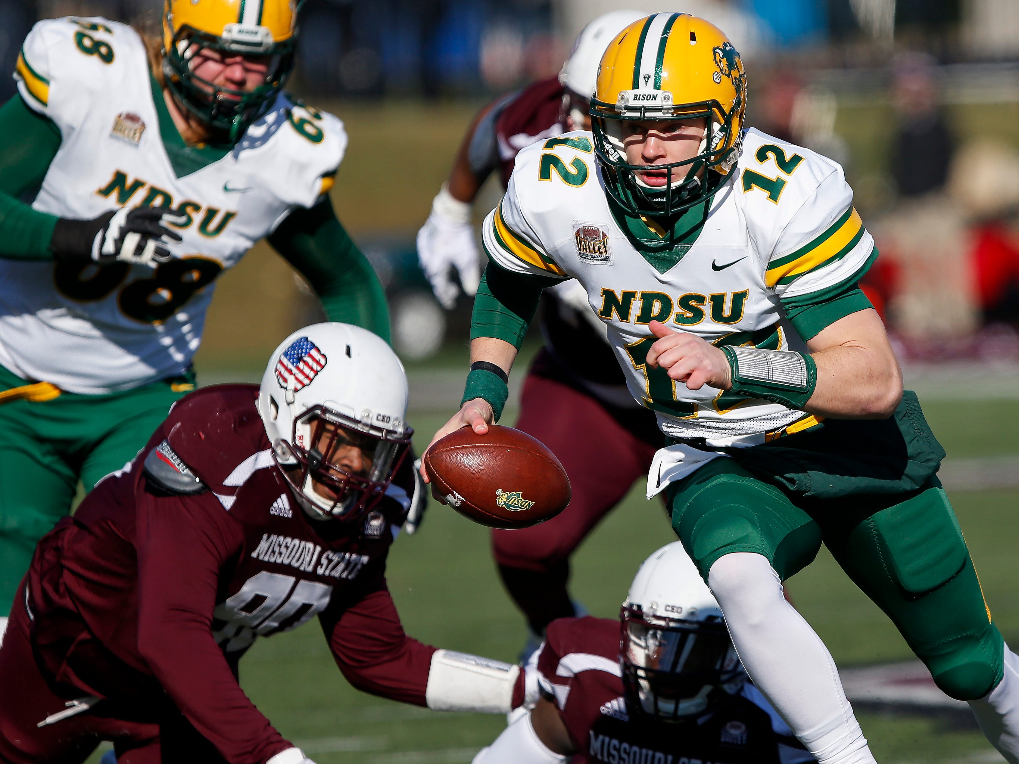 North Dakota State quarterback Easton Stick runs with the ball during their game against Missouri State University at Plaster Stadium on Saturday, Nov. 10, 2018.