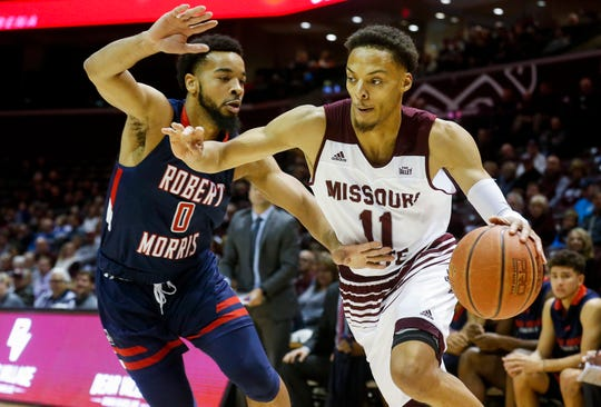 Jarred Dixon, of Missouri State University, drives across the baseline against Josh Williams, of Robert Morris, during the Bears game at JQH Arena on Friday, Nov. 9, 2018.