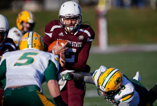 Missouri State University's Peyton Huslig runs the ball in the Bear's last home game of the season against North Dakota State at Plaster Stadium on Saturday, Nov. 10, 2018.