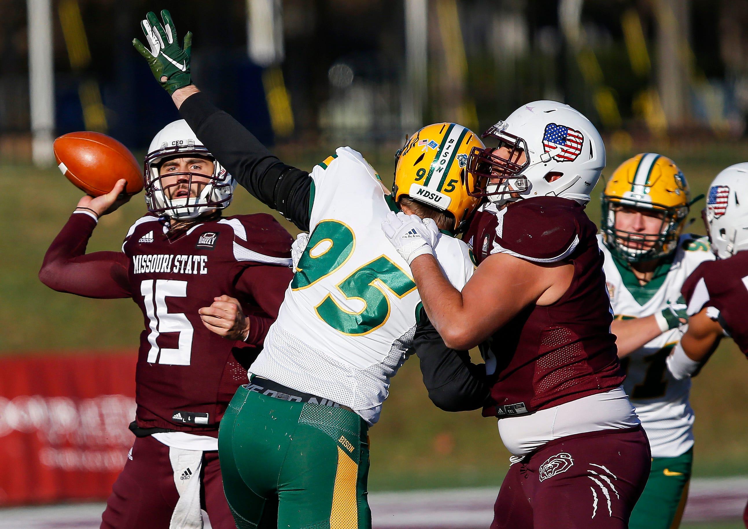 Missouri State University's Peyton Huslig passes the ball in the Bear's last home game of the season against North Dakota State at Plaster Stadium on Saturday, Nov. 10, 2018.