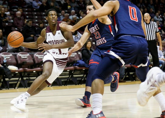 Keandre Cook, of Missouri State University, moves the ball against Robert Morris defenders during the Bears game at JQH Arena on Friday, Nov. 9, 2018.