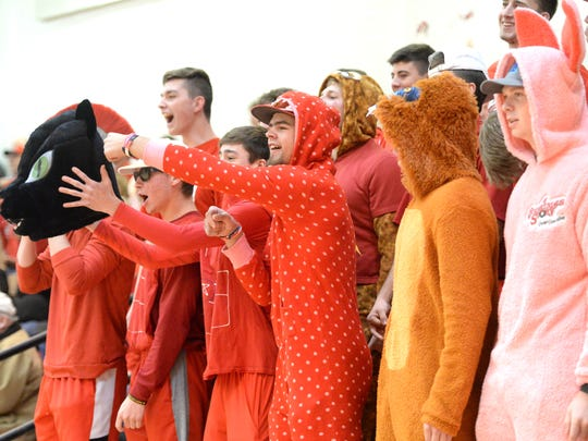 Riverheads fans cheer on the volleyball team Saturday afternoon in the Class 1 state quarterfinal match against Middlesex.