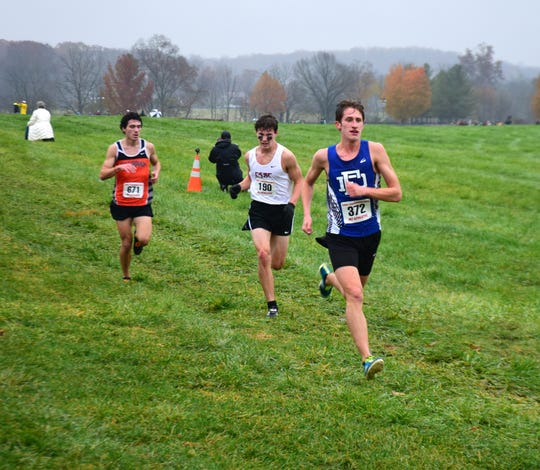 Fort Defiance's Jacob Jones, right, heads for the finish line of the Class 3 boys race at the VHSL Cross Country Championships on Friday, Nov. 9, 2018, at Great Meadow in The Plains, Va.