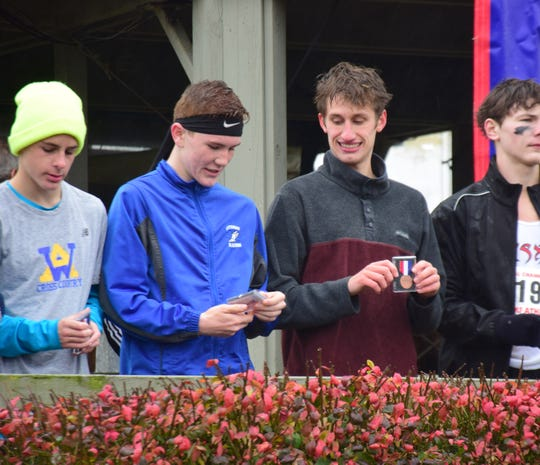 Fort Defiance's Jacob Jones, right, chats with Spotswood's Connor Amberg, left, during the awards ceremony for the Class 3 boys race at the VHSL Cross Country Championships on Friday, Nov. 9, 2018, at Great Meadow in The Plains, Va.