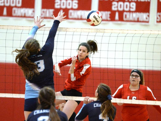 Riverheads' Abbey Eavers with the attack Saturday afternoon in the Class 1 state quarterfinal volleyball match against Middlesex.