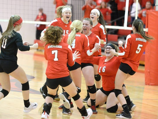 Riverheads players celebrate Saturday after beating Middlesex to advance to the Class 1 state volleyball semifinals.