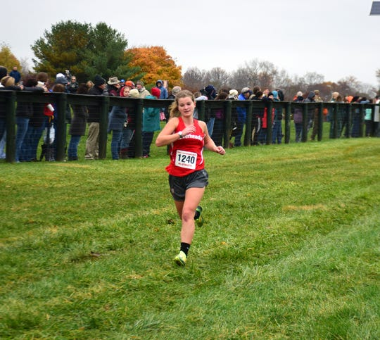 Riverheads' Kordelia Hunsberger strides for the finish line of the Class 1 girls race at the VHSL Cross Country Championships on Friday, Nov. 9, 2018, at Great Meadow in The Plains, Va.