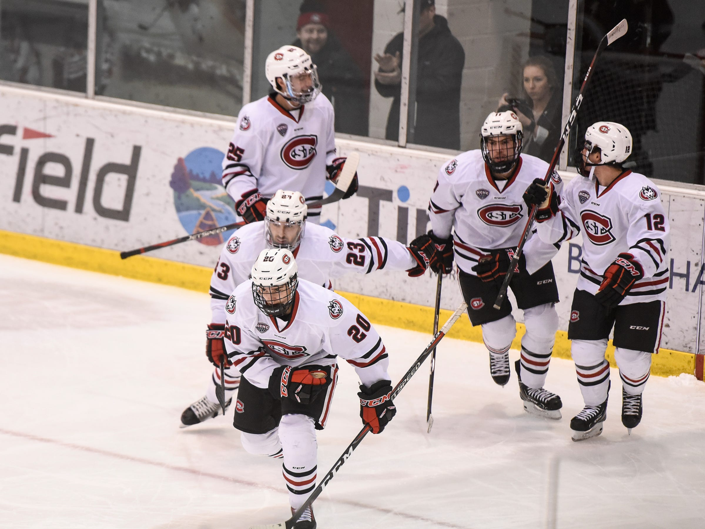 St. Cloud State players celebrate a goal by Nolan Walker during the first period of the Friday, Nov. 9, game against Denver at the Herb Brooks National Hockey Center in St. Cloud.