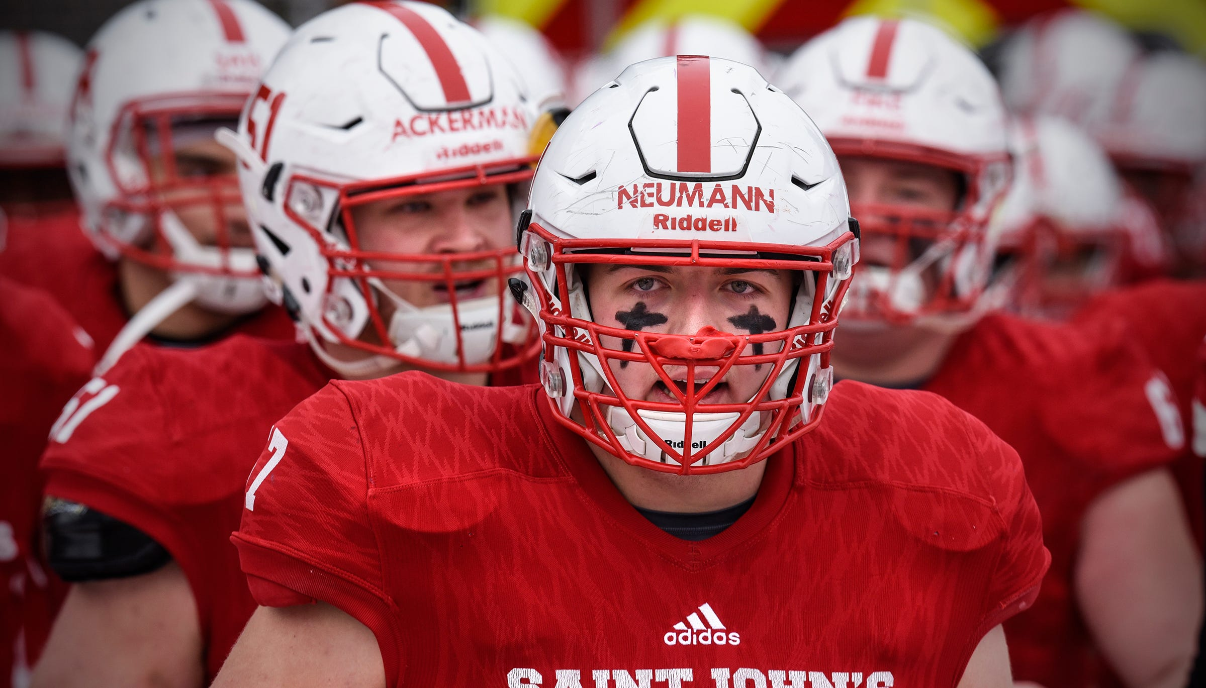 St. John's players take the field for the first half of the Saturday, Nov. 10, game against Thomas More University at Clemens Stadium in Collegeville.