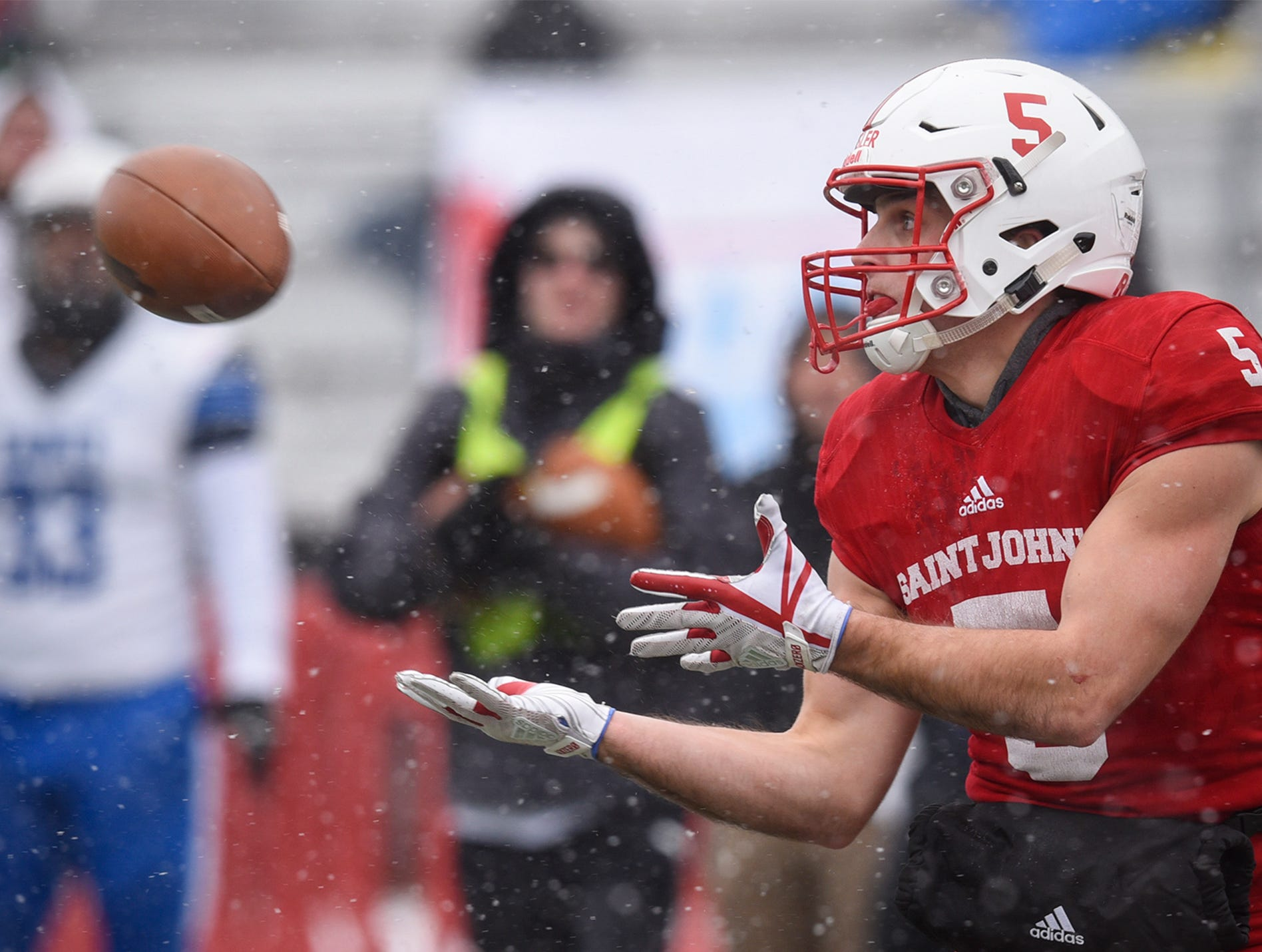 Adam Essler concentrates on the ball while catching a pass during the first half of the Saturday, Nov. 10, game against Thomas More University at Clemens Stadium in Collegeville.