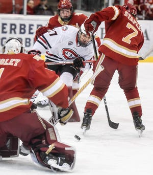 St. Cloud State's Blake Lizotte takes a shot on Denver goaltender Devin Cooley during the first period of the Friday, Nov. 9, game at the Herb Brooks National Hockey Center in St. Cloud.