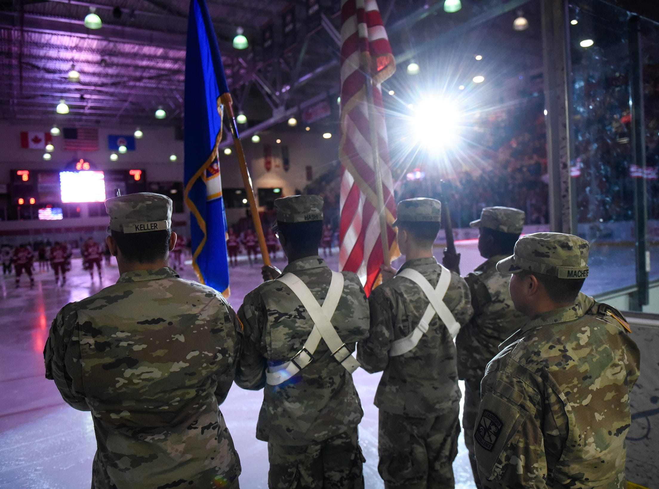 ROTC Color Guard members take part in the National Anthem before the start of the Friday, Nov. 9, game against Denver at the Herb Brooks National Hockey Center in St. Cloud.