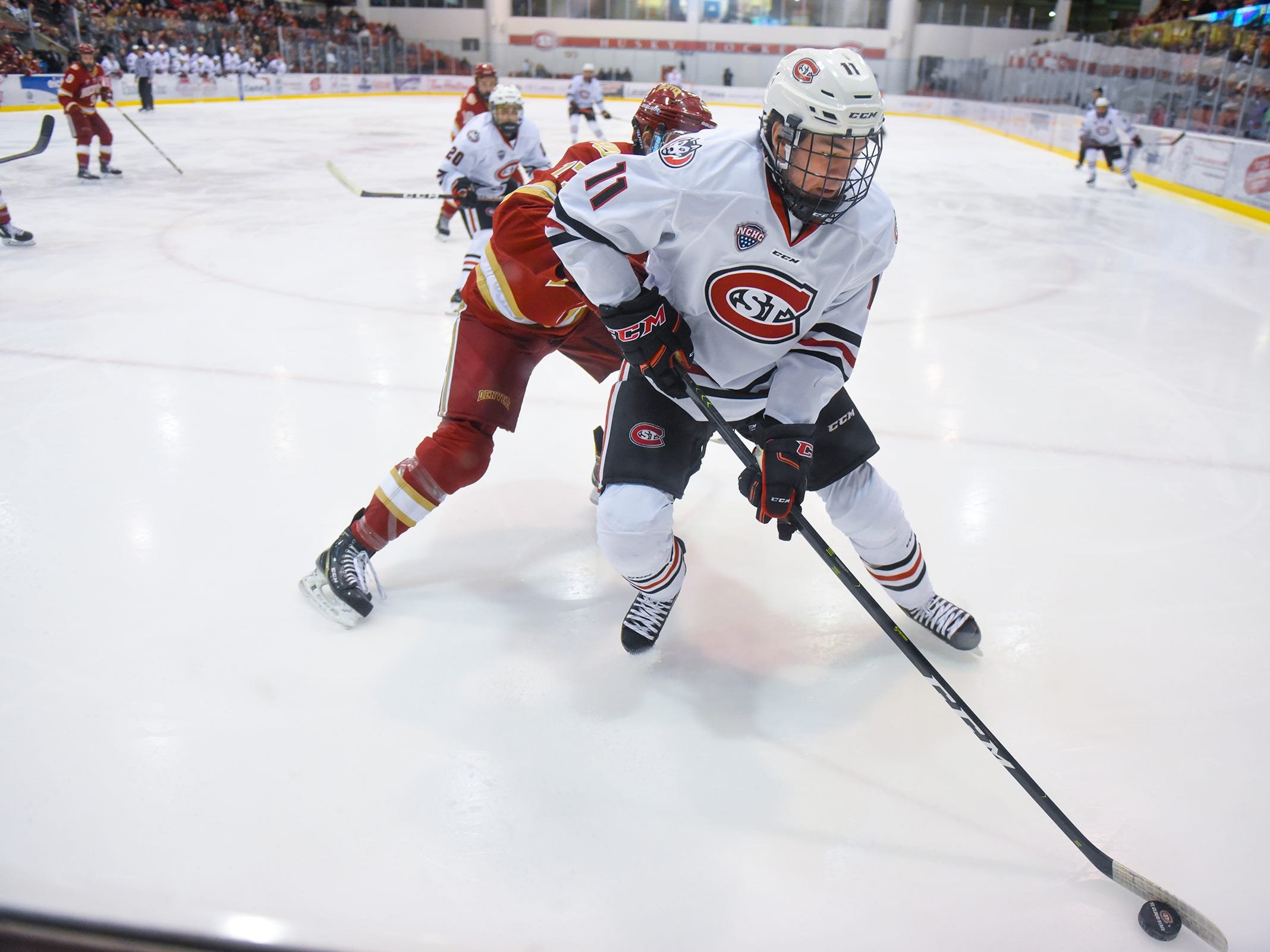 St. Cloud State's Ryan Poehling gets control of the puck along the boards during the first period of the Friday, Nov. 9, game against Denver at the Herb Brooks National Hockey Center in St. Cloud.