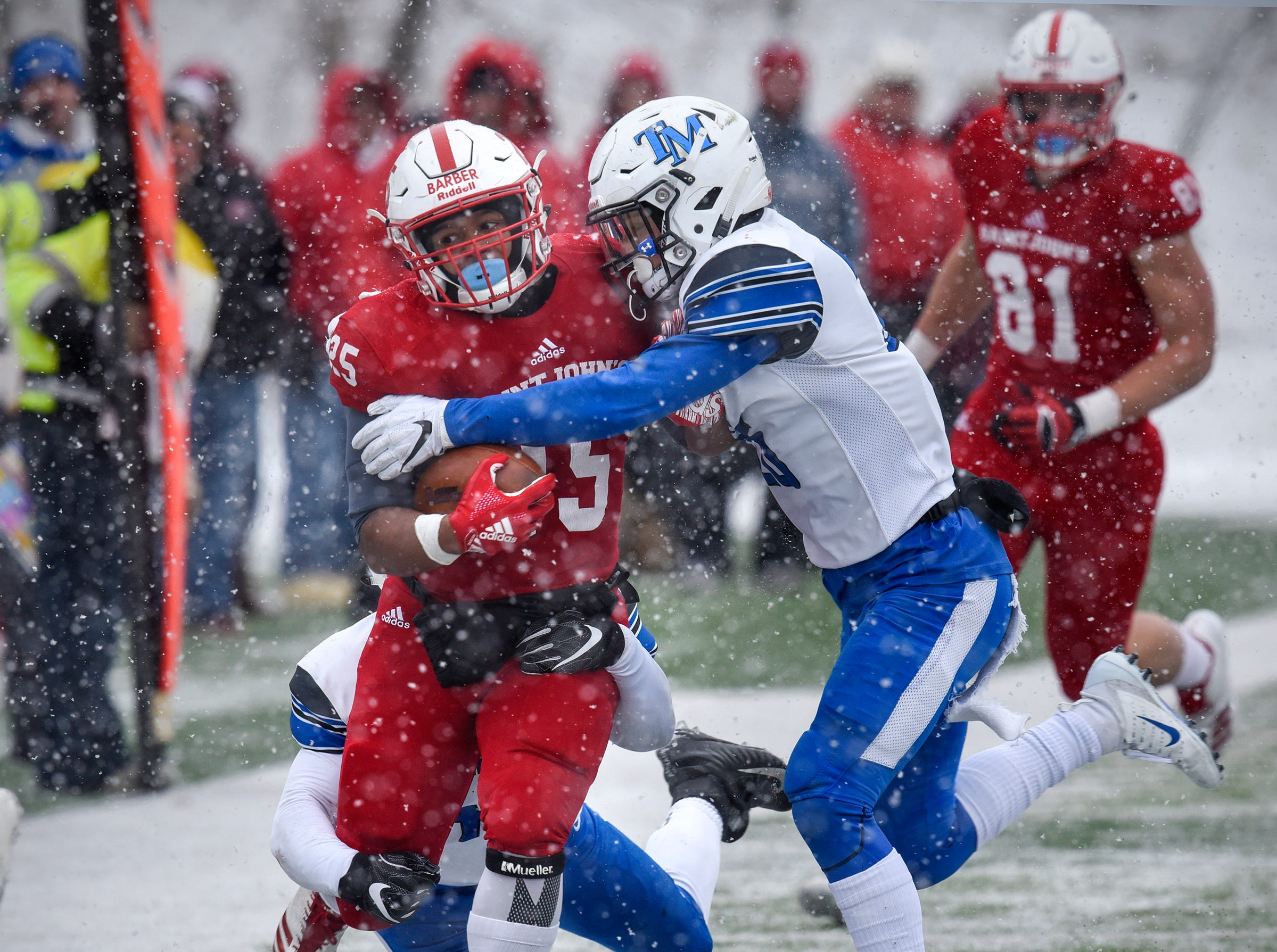 St. John's gains yardage during the first half of the Saturday, Nov. 10, game against Thomas More University at Clemens Stadium in Collegeville.