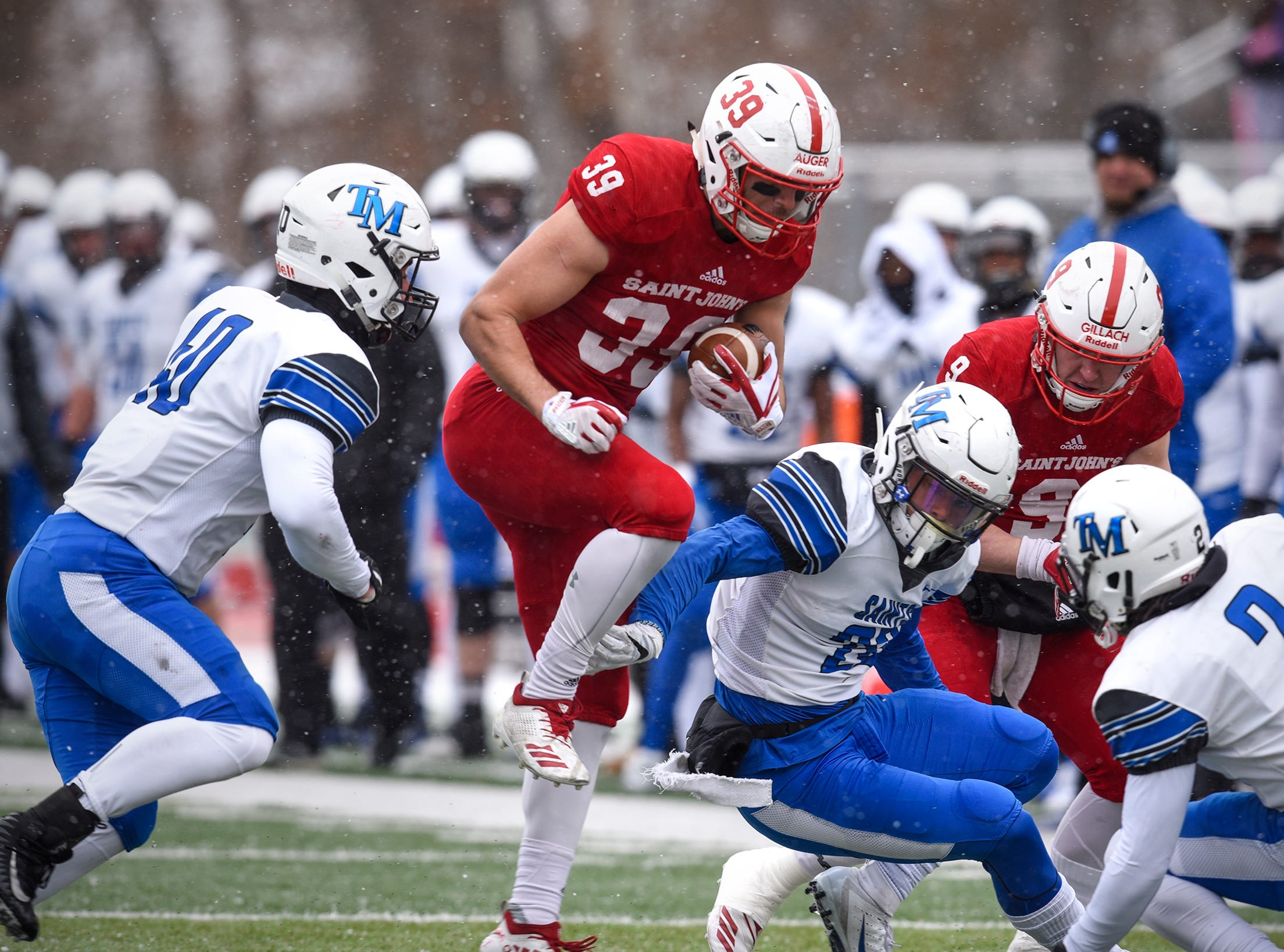 Tommy Auger carries the ball for St. John's during the first half of the Saturday, Nov. 10, game against Thomas More University at Clemens Stadium in Collegeville.