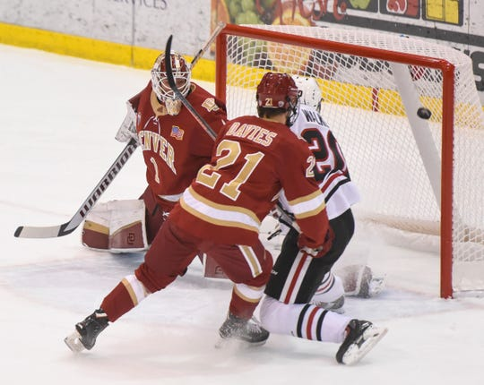 Nolan Walker scores the first goal of the game for the Huskies during the first period Friday, Nov. 9, against Denver at the Herb Brooks National Hockey Center in St. Cloud.